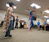 """Tyler Carach, nicknamed """"Donut Boy,"""" celebrated his 11th birthday with the Pensacola Police Department and members of the Harlem Globetrotters."""