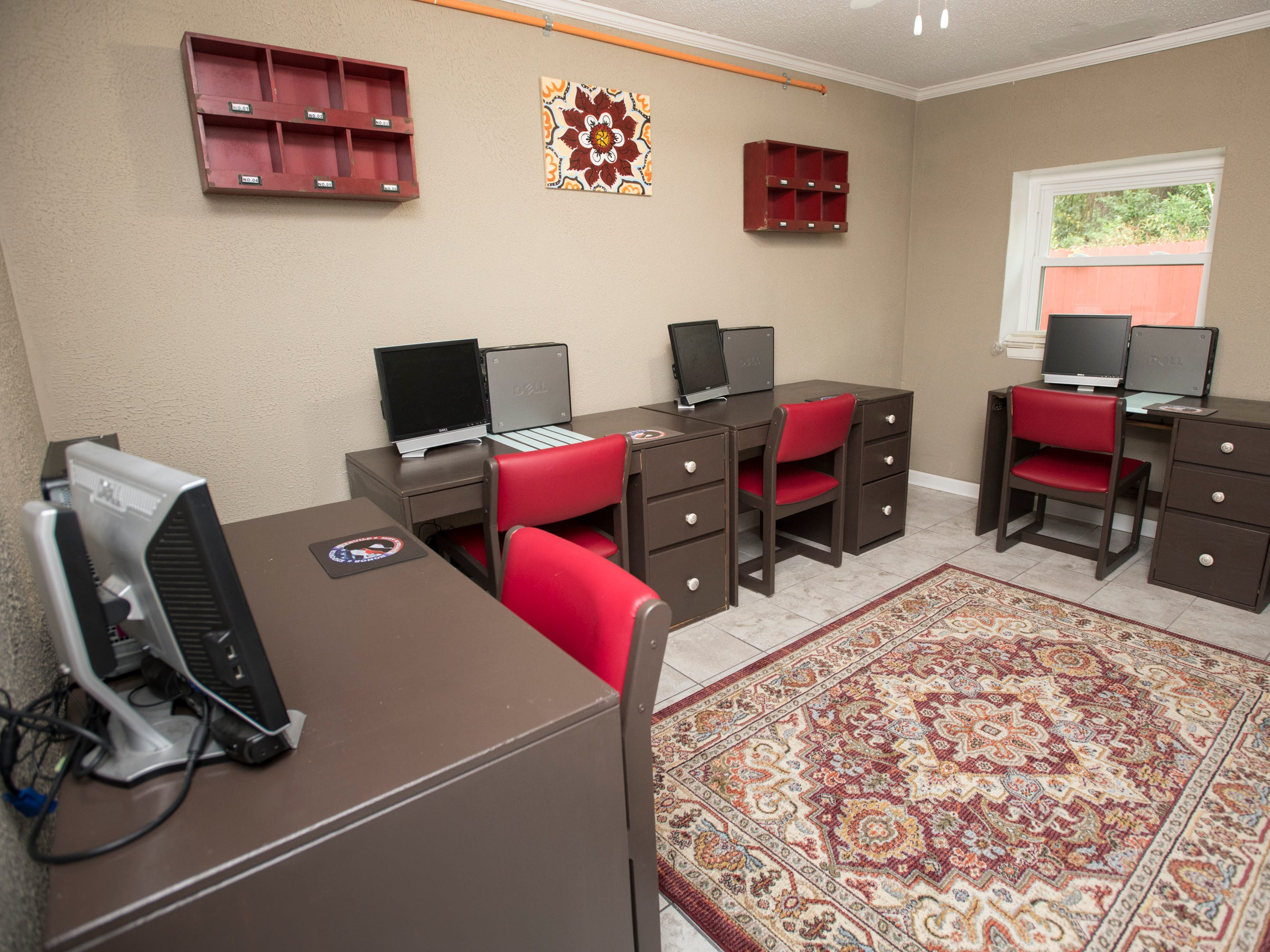 The computer room at the HER Foundation Faith House on West Fairfield Drive in Pensacola on Wednesday, November 7, 2018.  This room was furnished and decorated by the Escambia County School District.