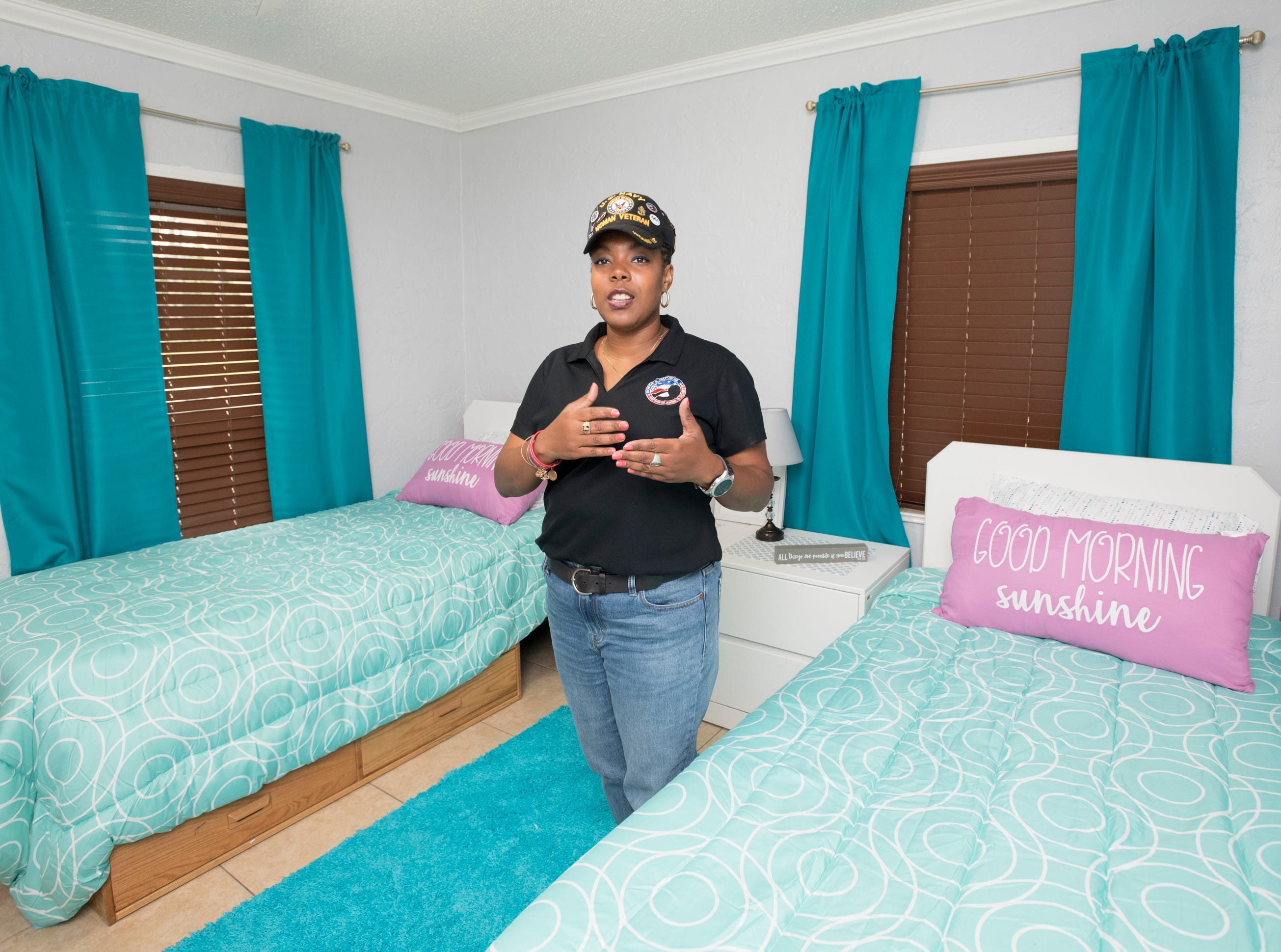 CEO and founder Nancy Bullock-Prevot proudly shows off one of the bedrooms at the HER Foundation Faith House on West Fairfield Drive in Pensacola on Wednesday, November 7, 2018.