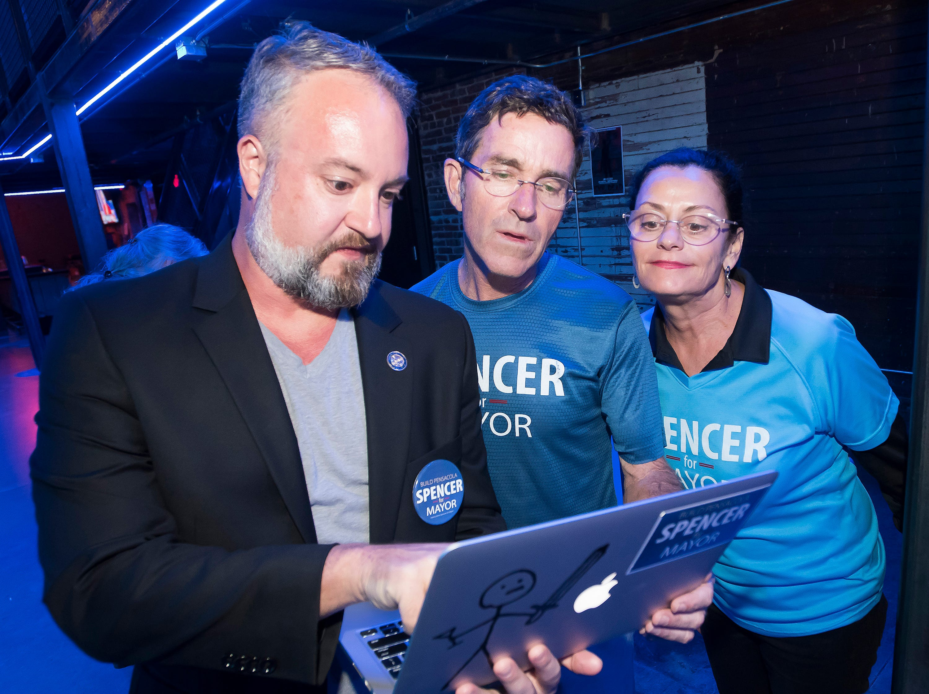 Mayoral candidate Brian Spencer, and his wife Crystal look on as Phil Nickinson monitors the election results during an end of campaign party at Vinyl on Tuesday, Nov. 6, 2018.