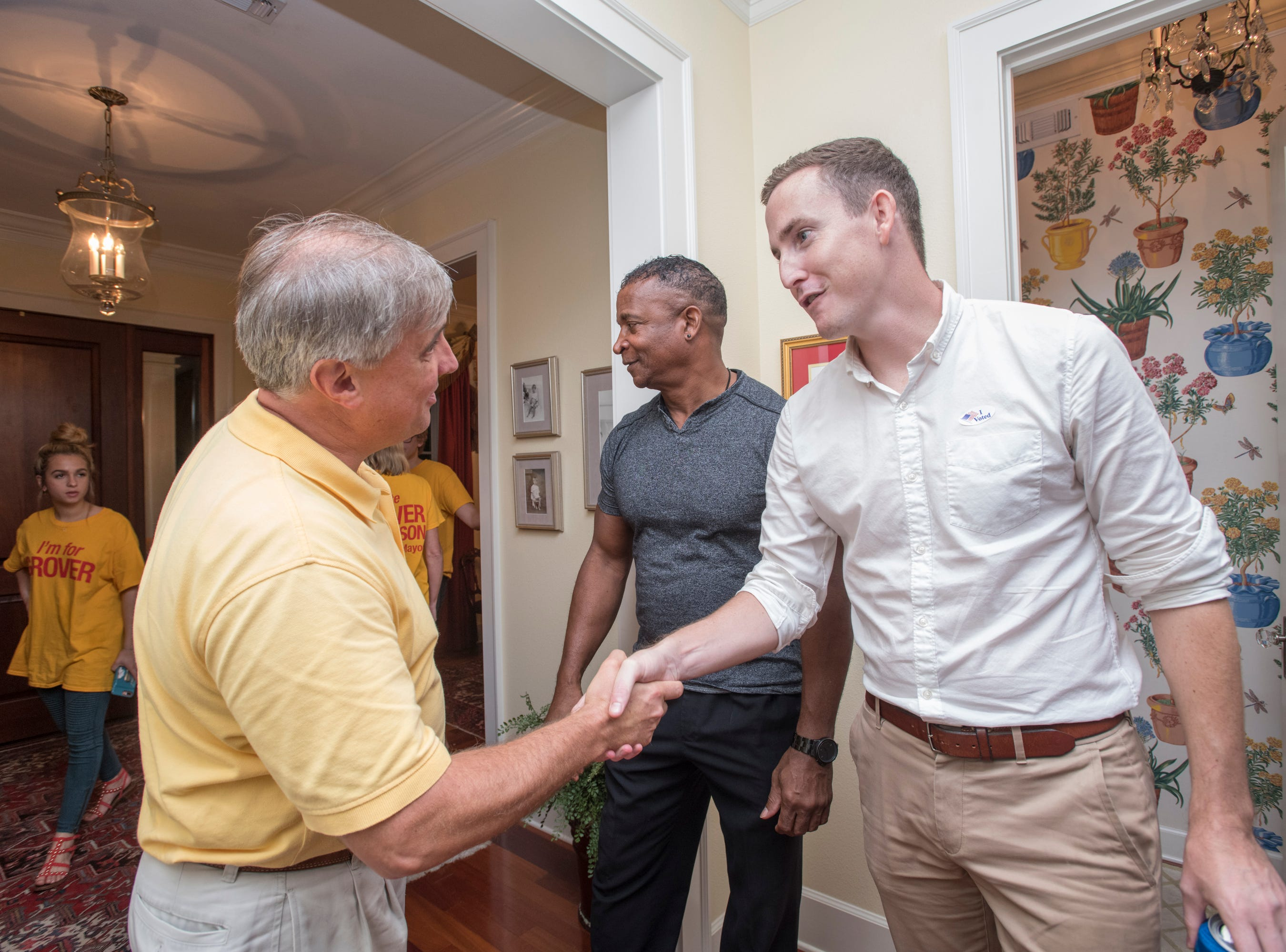 Penscola Mayoral candidate Grover Robinson, left, greets supporters on Election Night in Pensacola on Tuesday, November 6, 2018.