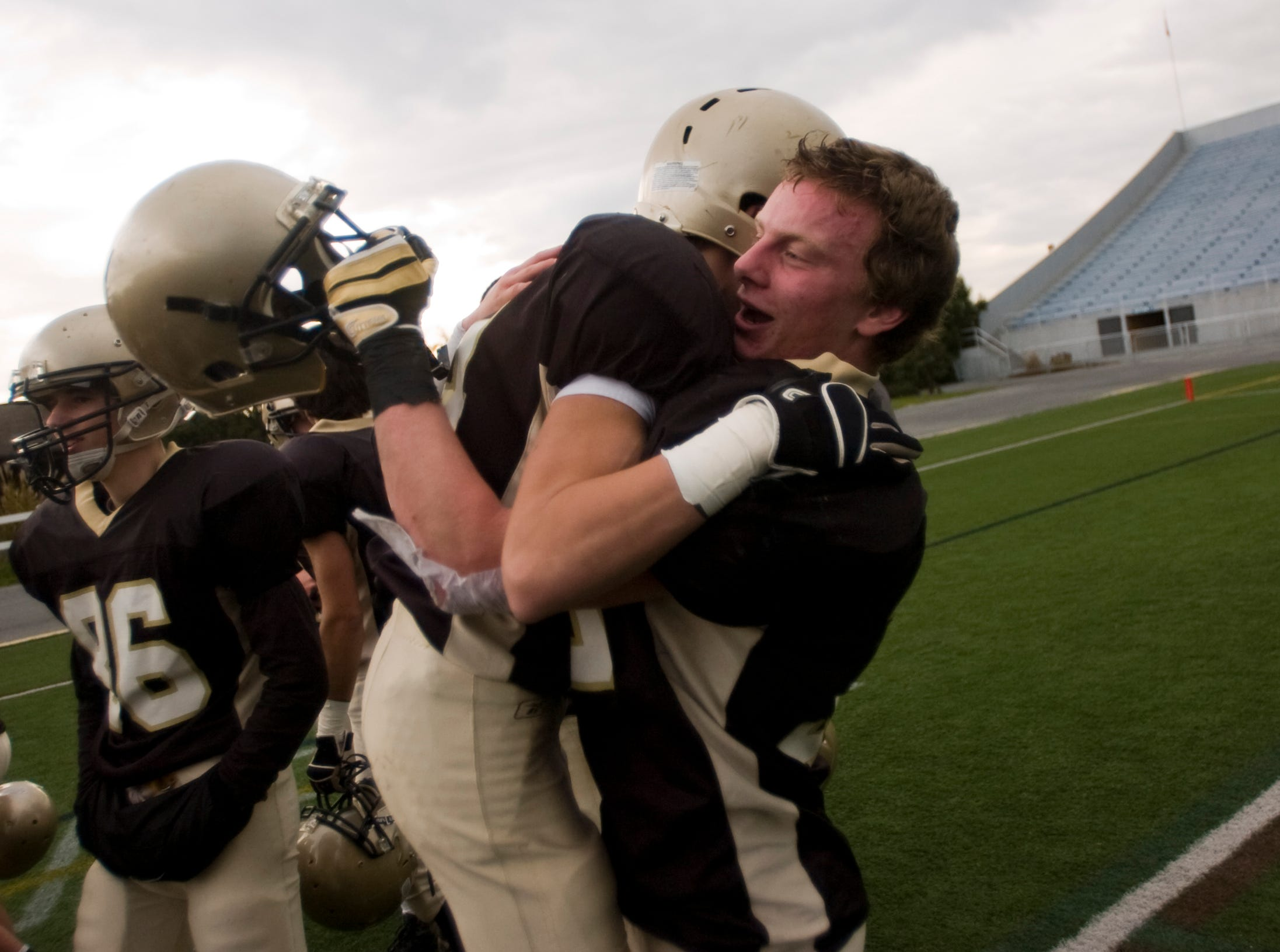 In this file photo from 2012, Delone's Matt Guiffreda hugs teammate Logan Hartlaub after their win against Steelton-Highspire in the District 3 Class A football championship on Friday in Hershey.