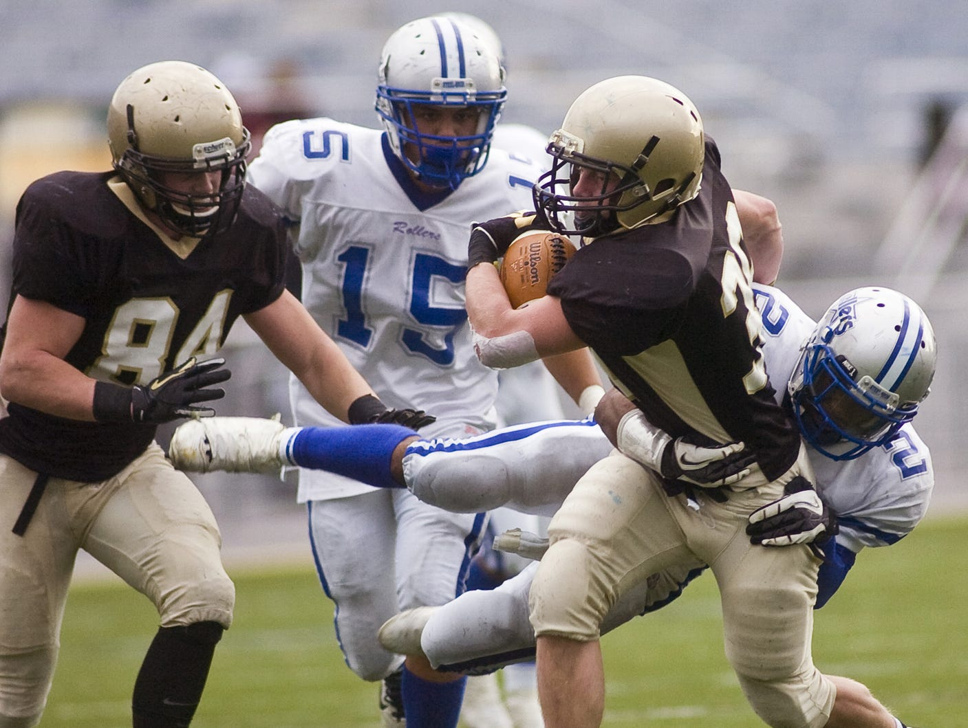 In this file photo from 2012, Delone's Matt Guiffreda carries the ball while Steelton's Dywan Blanding leaps in for a tackle during Friday's District 3 Class A football championship game at Hershey Stadium.