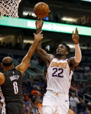 Phoenix Suns center Deandre Ayton is fouled by Brooklyn Nets forward Jared Dudley (6) during the second half of an NBA basketball game Tuesday, Nov. 6, 2018, in Phoenix. The Nets won 104-82. (AP Photo/Rick Scuteri)