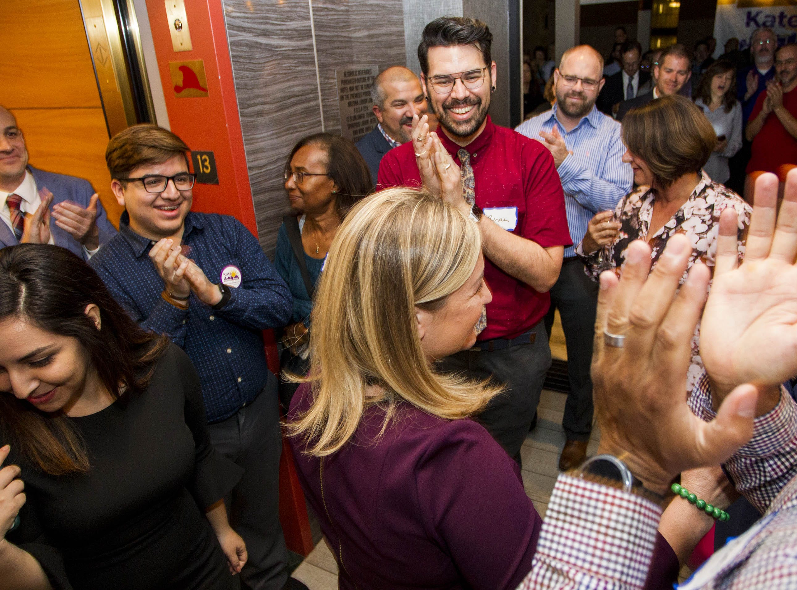 Phoenix mayoral candidate Kate Gallego gets a round of applause from constituents at the Hilton Garden Inn in Phoenix on Nov. 6, 2018.