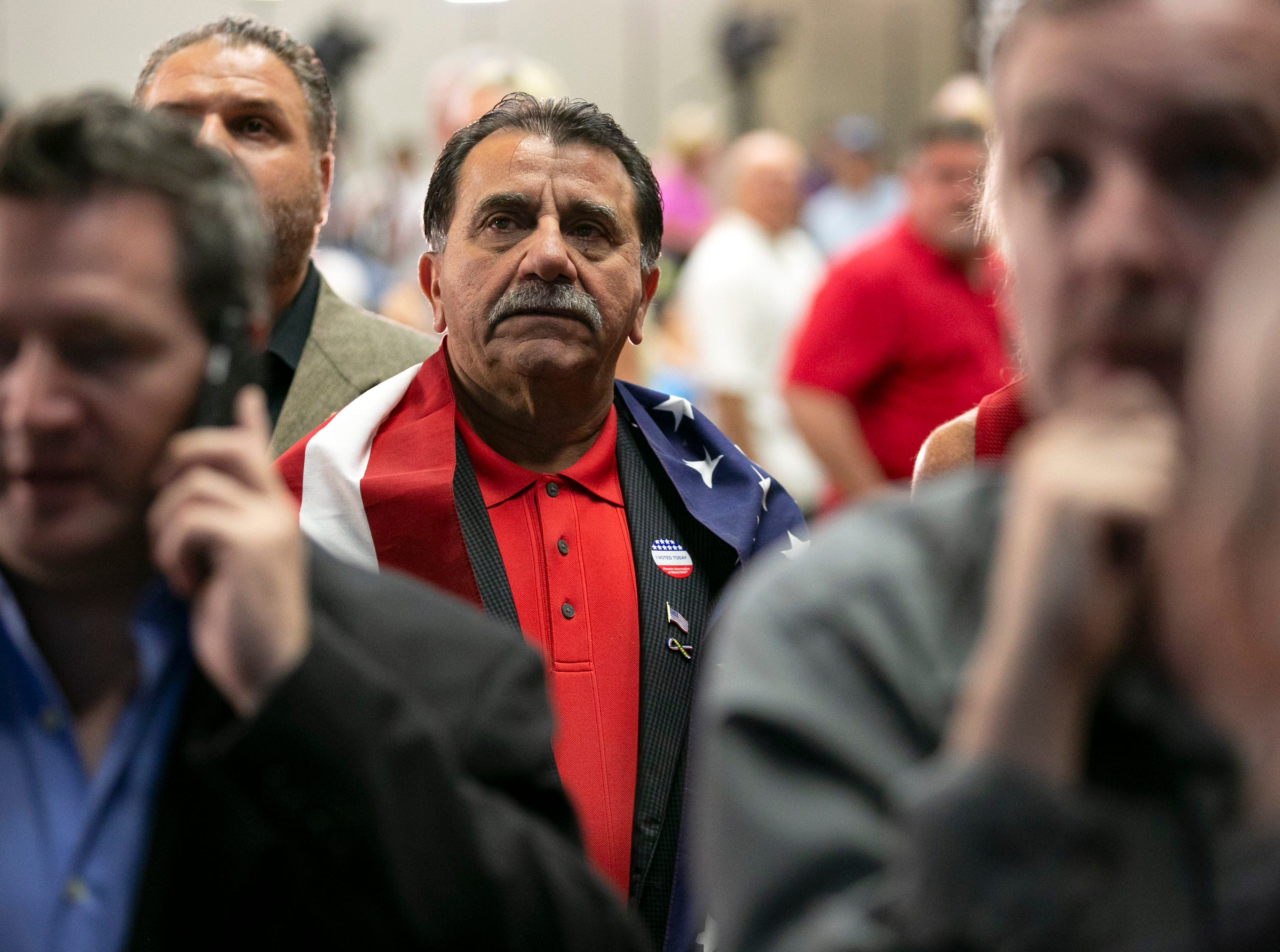Republican Ashur Warda (center) of Peoria watches early results during the Republican watch party at the DoubleTree Resort in Scottsdale on Election Day for the midterms on Tuesday, November 6, 2018.