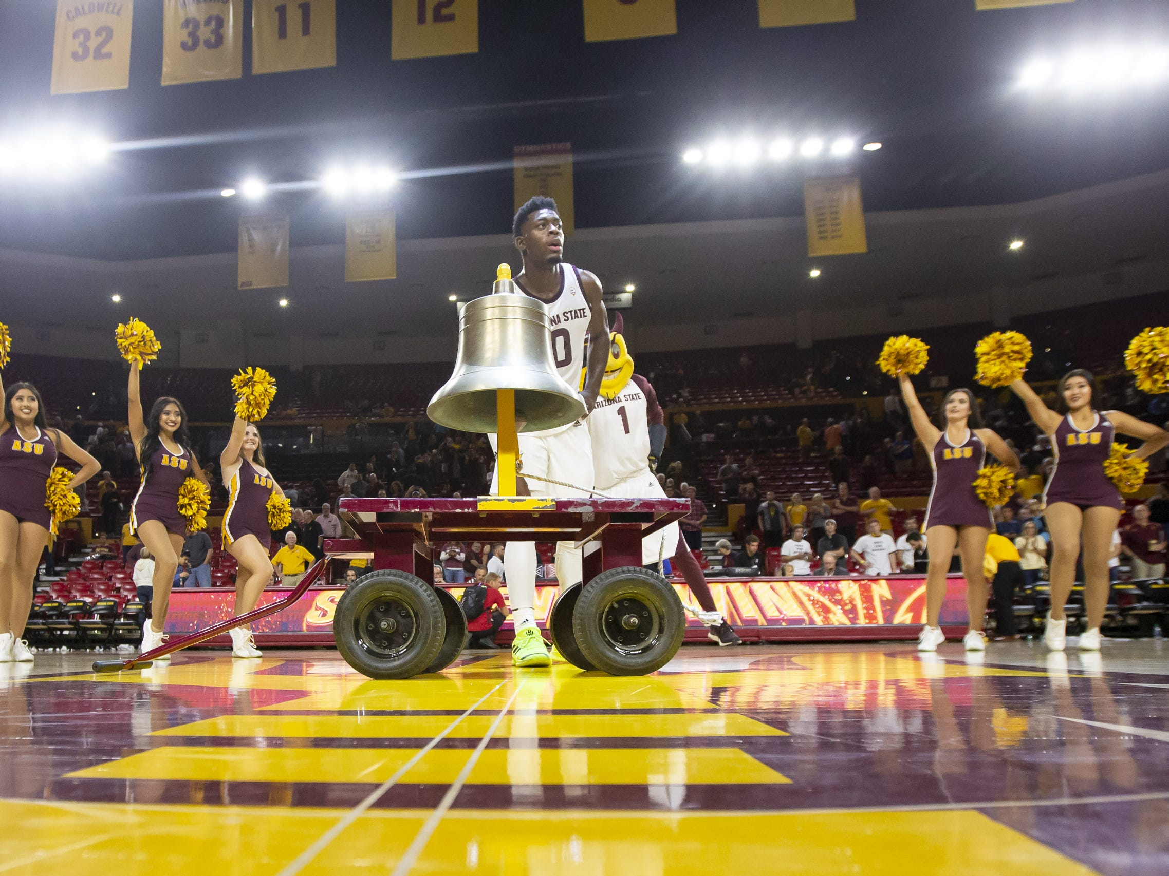 Guard Luguentz Dort (0) of the Arizona State Sun Devils rings the victory bell following Arizona State's double overtime win against the Cal State Fullerton Titans at Wells Fargo Arena on Tuesday, November 6, 2018 in Tempe, Arizona.