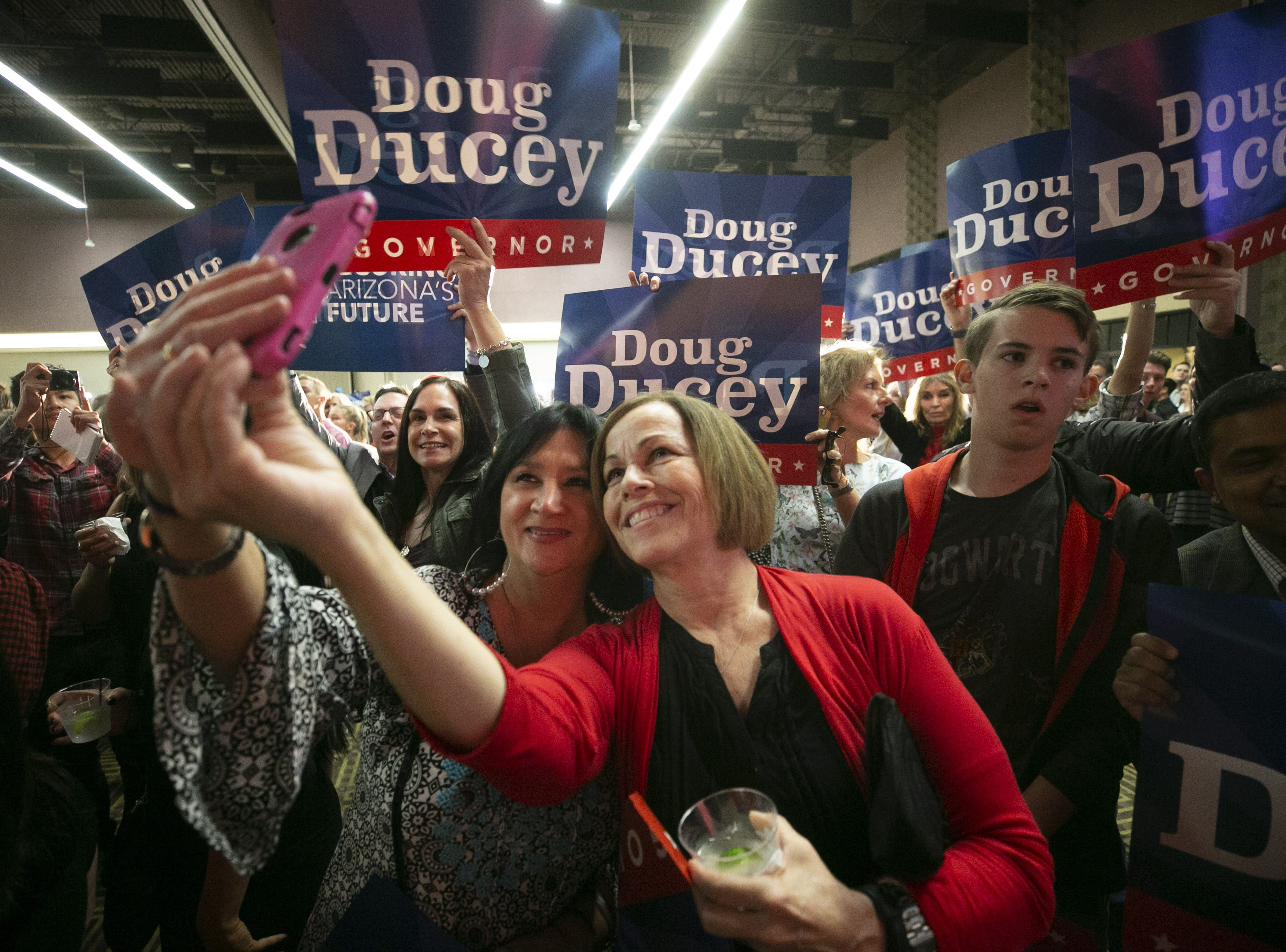 Gov. Doug Ducey supporters take a selfie before Ducey speaks at the Republican watch party at the DoubleTree Resort in Scottsdale on  Nov. 6, 2018.