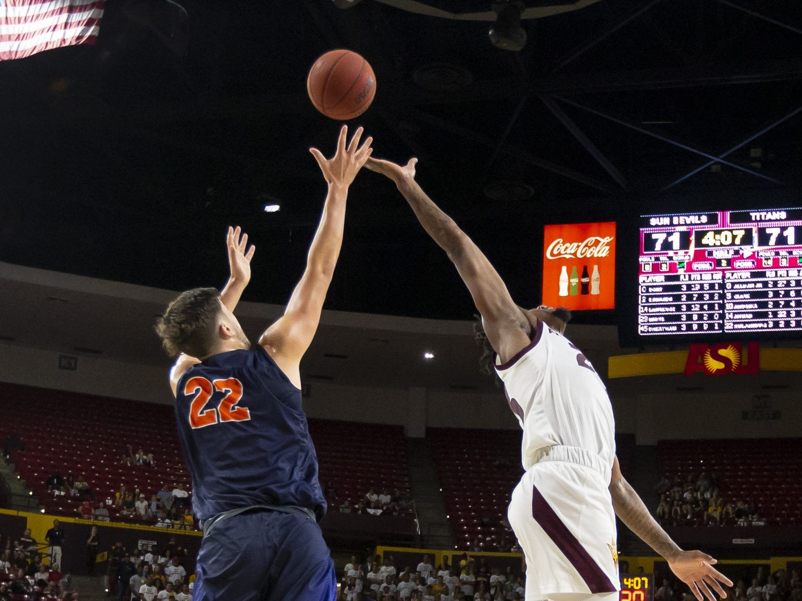 Forward Amel Kuljuhovic (22) of the Cal State Fullerton Titans and forward Romello White (23) of the Arizona State Sun Devils reach for the ball at Wells Fargo Arena on Tuesday, November 6, 2018 in Tempe, Arizona.