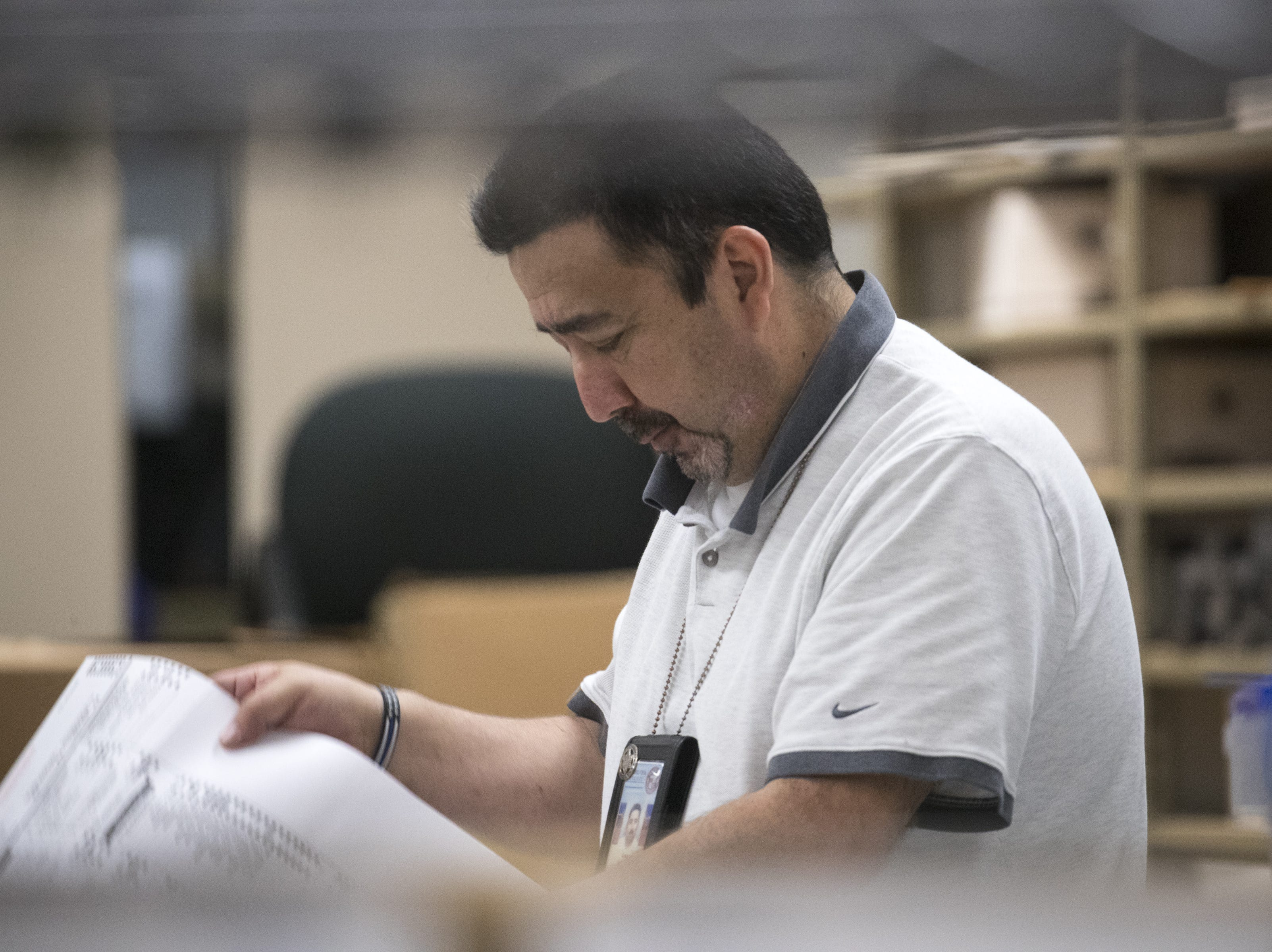 Gary Ramirez processes ballots on Nov. 7, 2018, at the Maricopa County Tabulation and Election Center, 510 S. 3rd Ave., Phoenix.