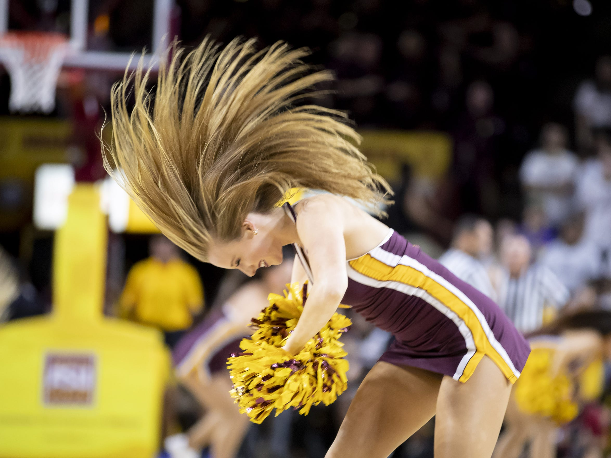 An Arizona State Sun Devil cheerleader flips her hair during the game against the Cal State Fullerton Titans at Wells Fargo Arena on Tuesday, November 6, 2018 in Tempe, Arizona.
