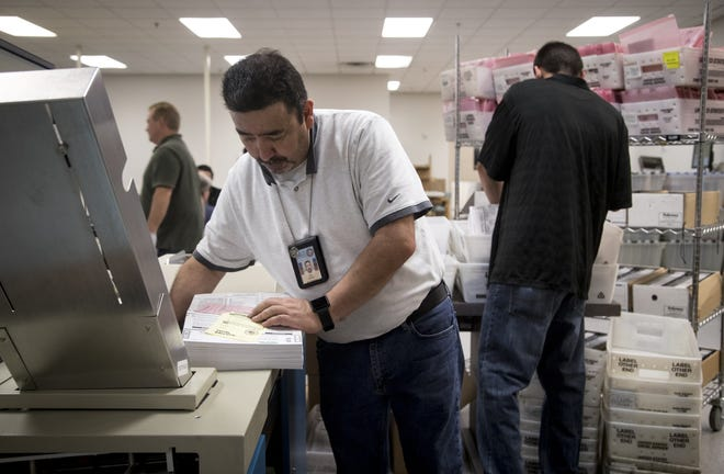Ballots are processed on Nov. 7, 2018, at the Maricopa County Tabulation and Election Center, 510 S. Third Ave., Phoenix.
