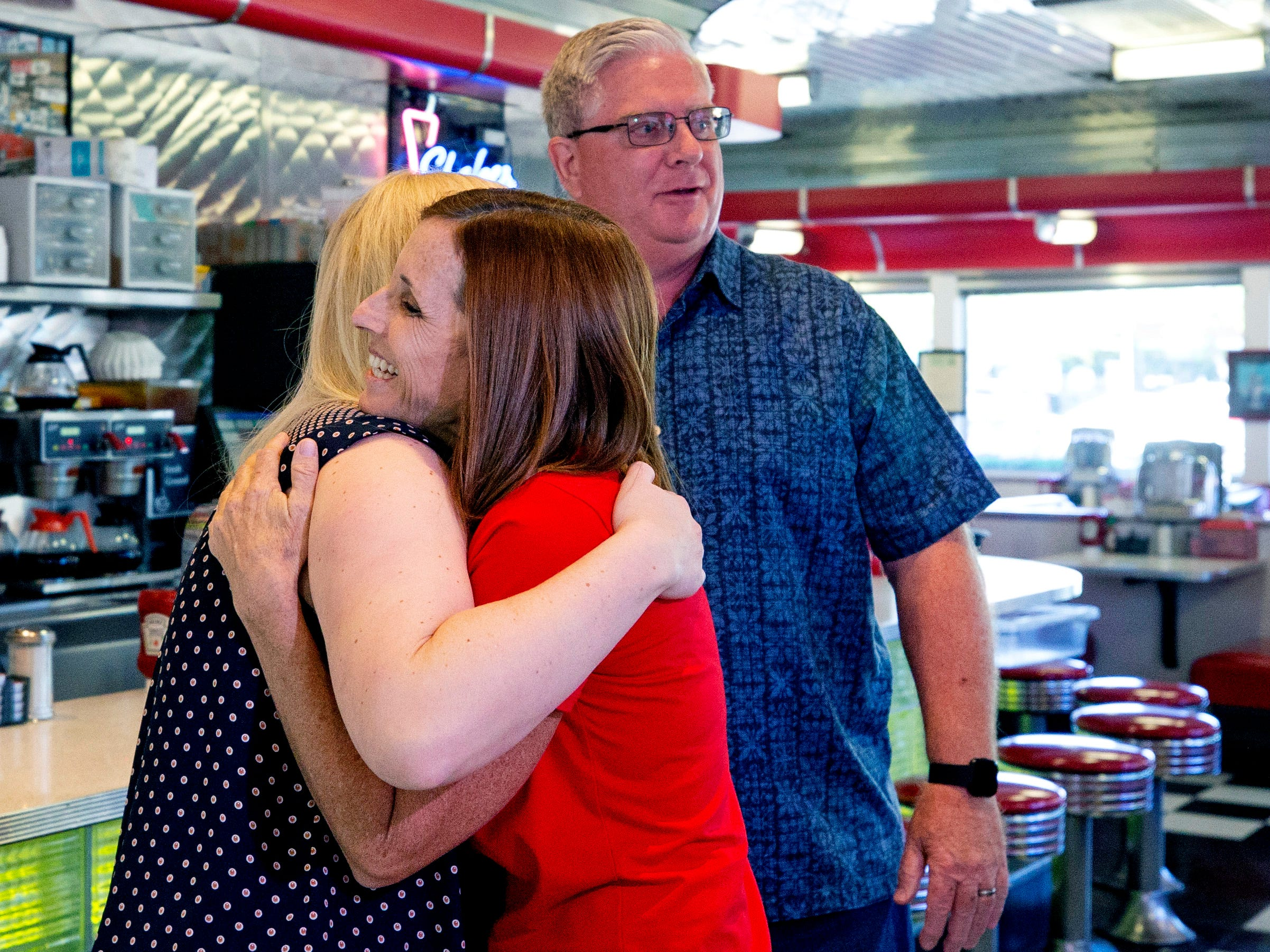 Jennifer Chase gets a hug from Rep. Martha McSally at Chase's Diner in Chandler on Nov. 6, 2018. Jennifer's father, Skip, right, owns, Chase's Diner.