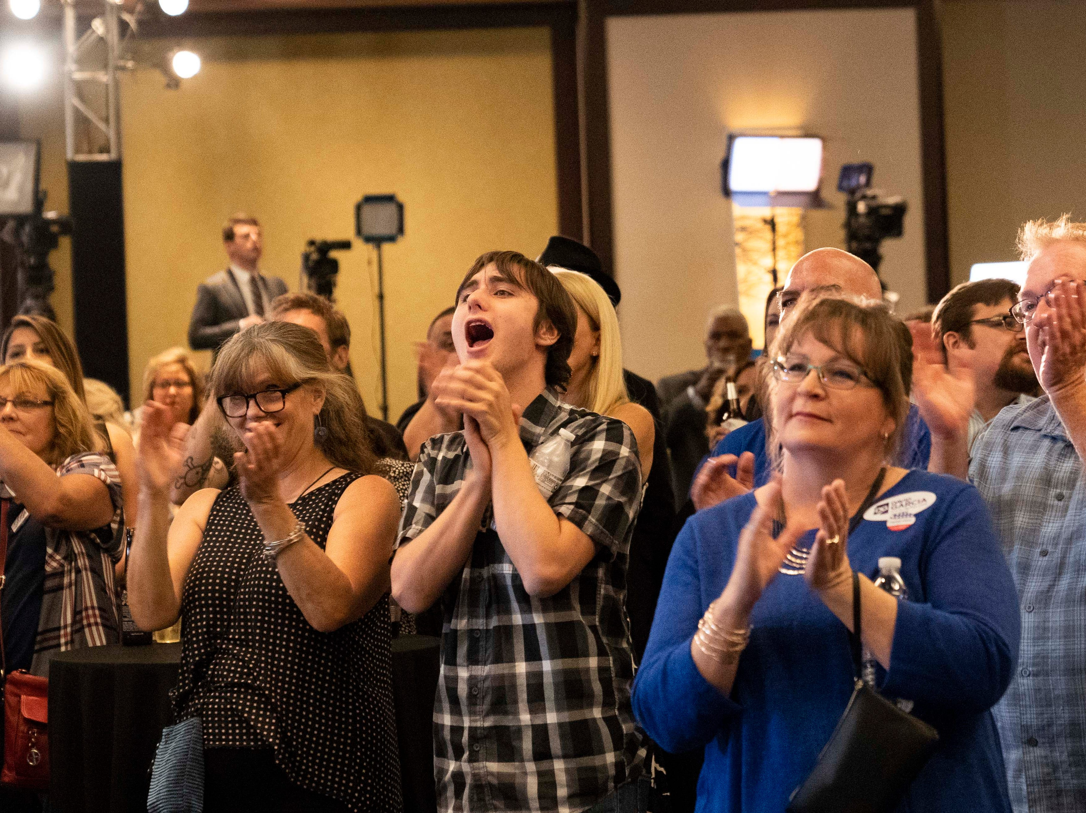 Democrat supporters cheer after hearing national results on CNN at the Renaissance Phoenix Downtown Hotel on Nov. 6, 2018.