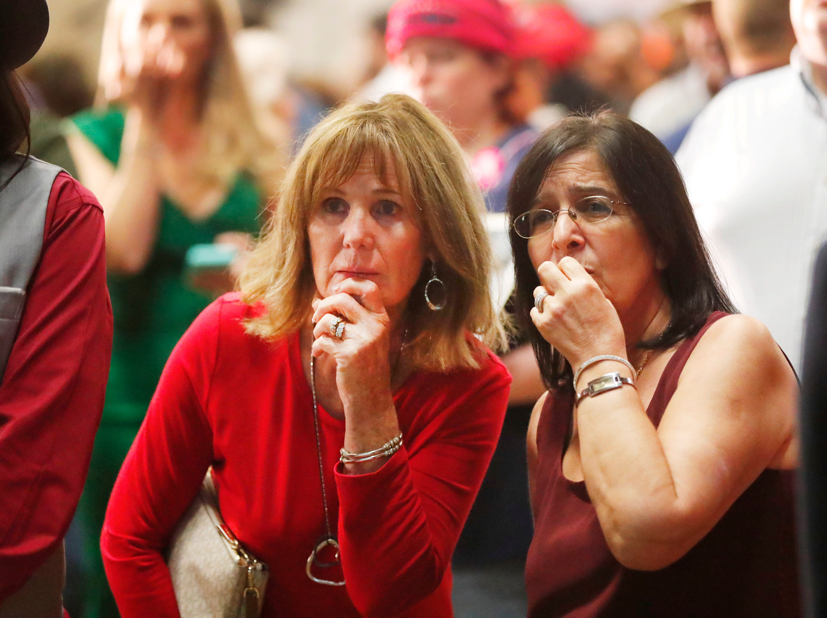 Angie Peterson (left) and Teresa Lariviere watch early returns on a screen during the Arizona Republican Party Election Night party in Scottsdale Nov. 6, 2018.