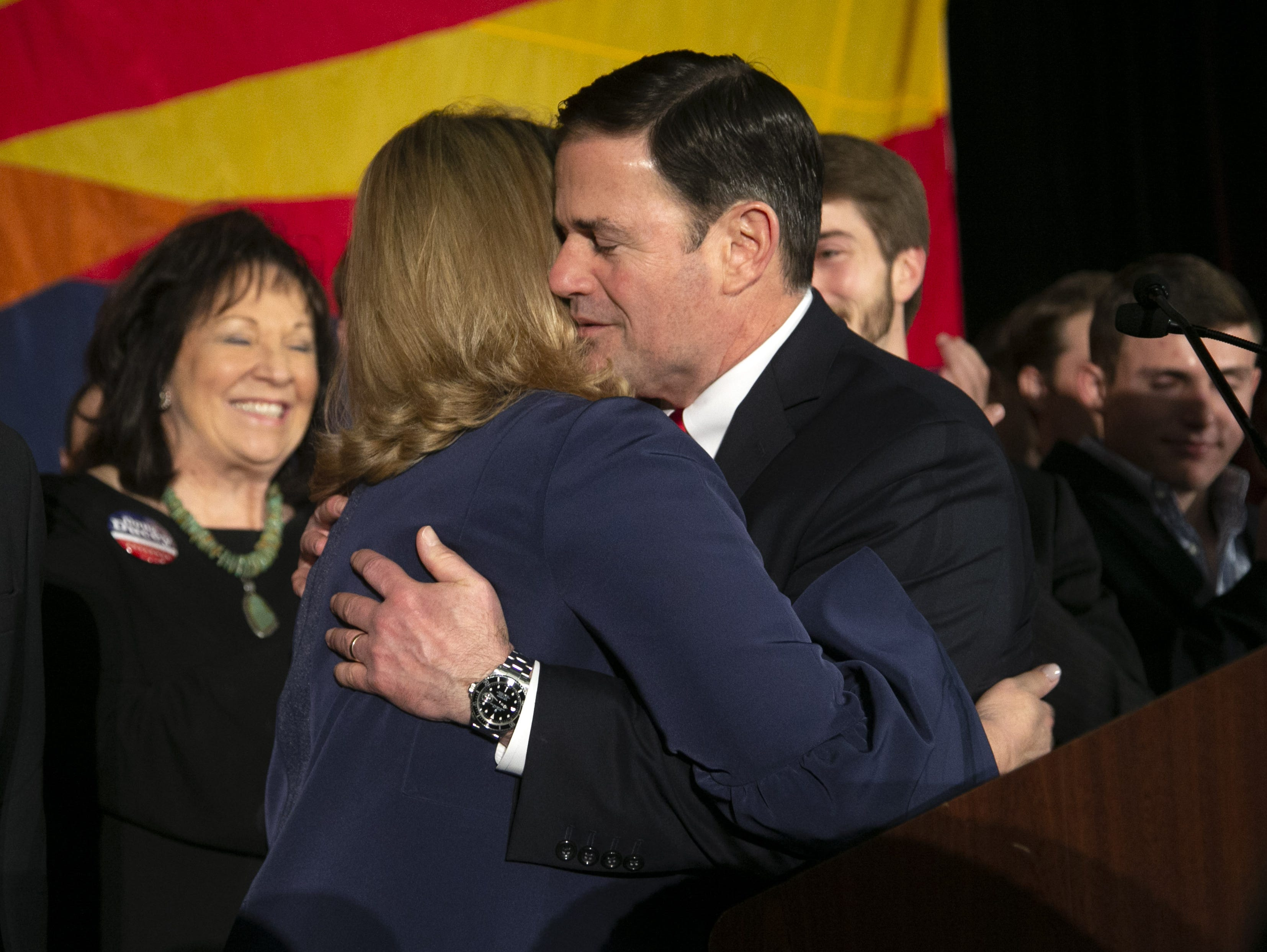 Gov. Doug Ducey speaks hugs his wife, Angela, during the Republican watch party at the DoubleTree Resort in Scottsdale on  Nov. 6, 2018.