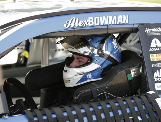 No. 88 driver Alex Bowman sits in his car after qualifying for the NASCAR Dayton 500 at the Daytona International Speedway on Feb. 11.