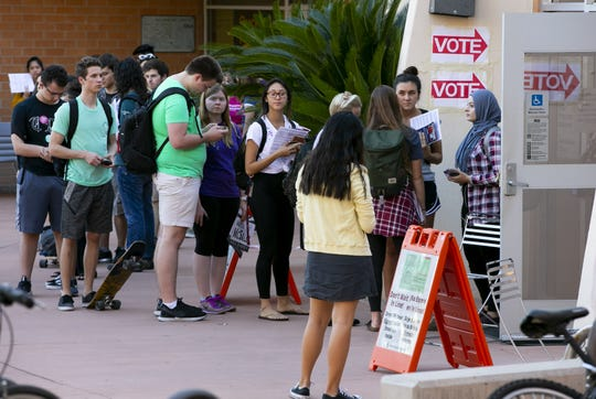 Arizona State University students wait in line for up to 2 1/2 hours to vote at the polling place on the ASU Tempe campus on Nov. 6, 2018.