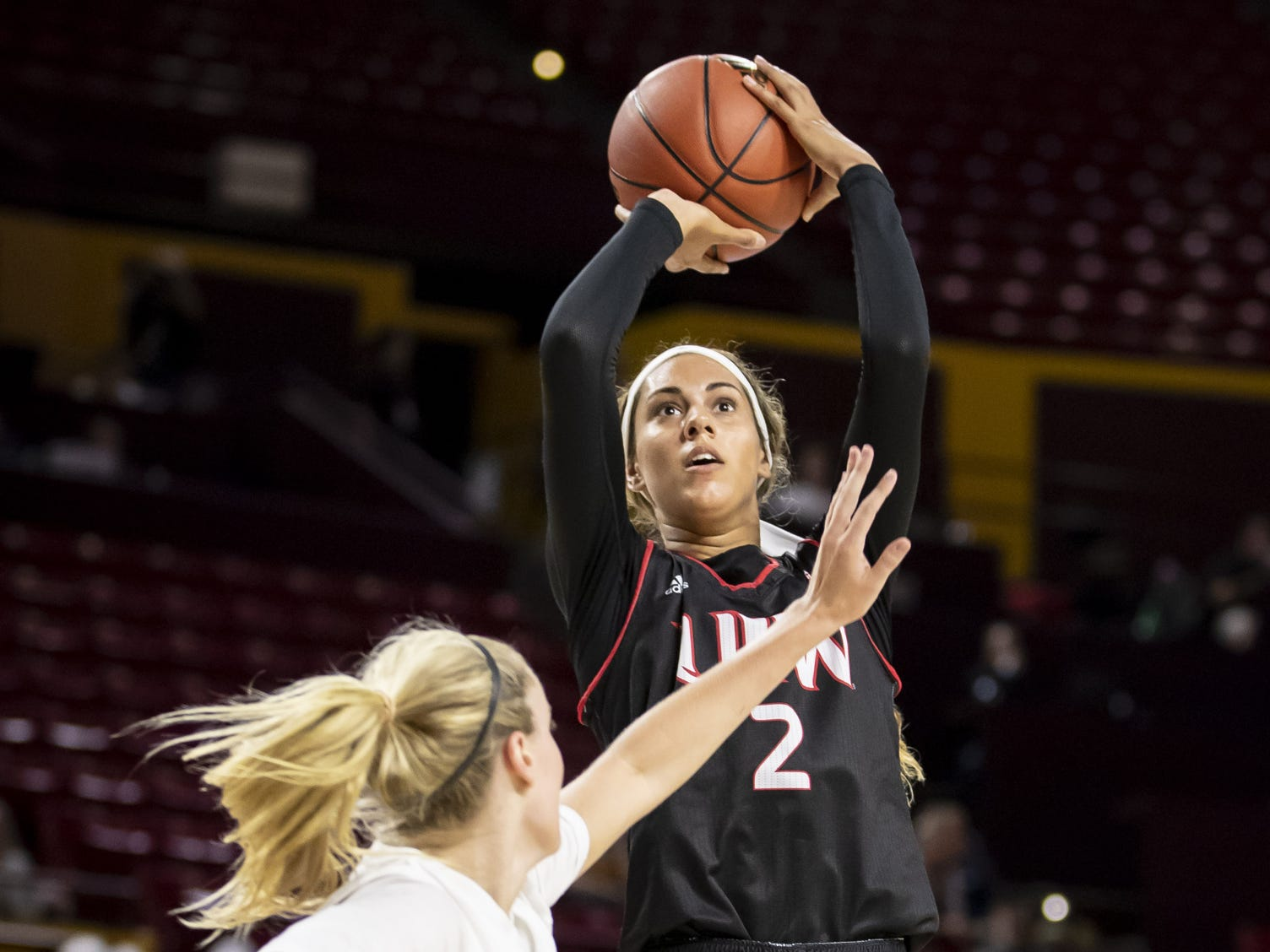 Forward Lunden Henry (2) of the Incarnate Word Cardinals shoots the ball against the Arizona State Sun Devils at Wells Fargo Arena on Tuesday, November 6, 2018 in Tempe, Arizona.