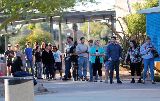 Voters wait in line to to cast their ballots at a polling station at the Tempe History Museum in Ariz. Nov. 6, 2018.