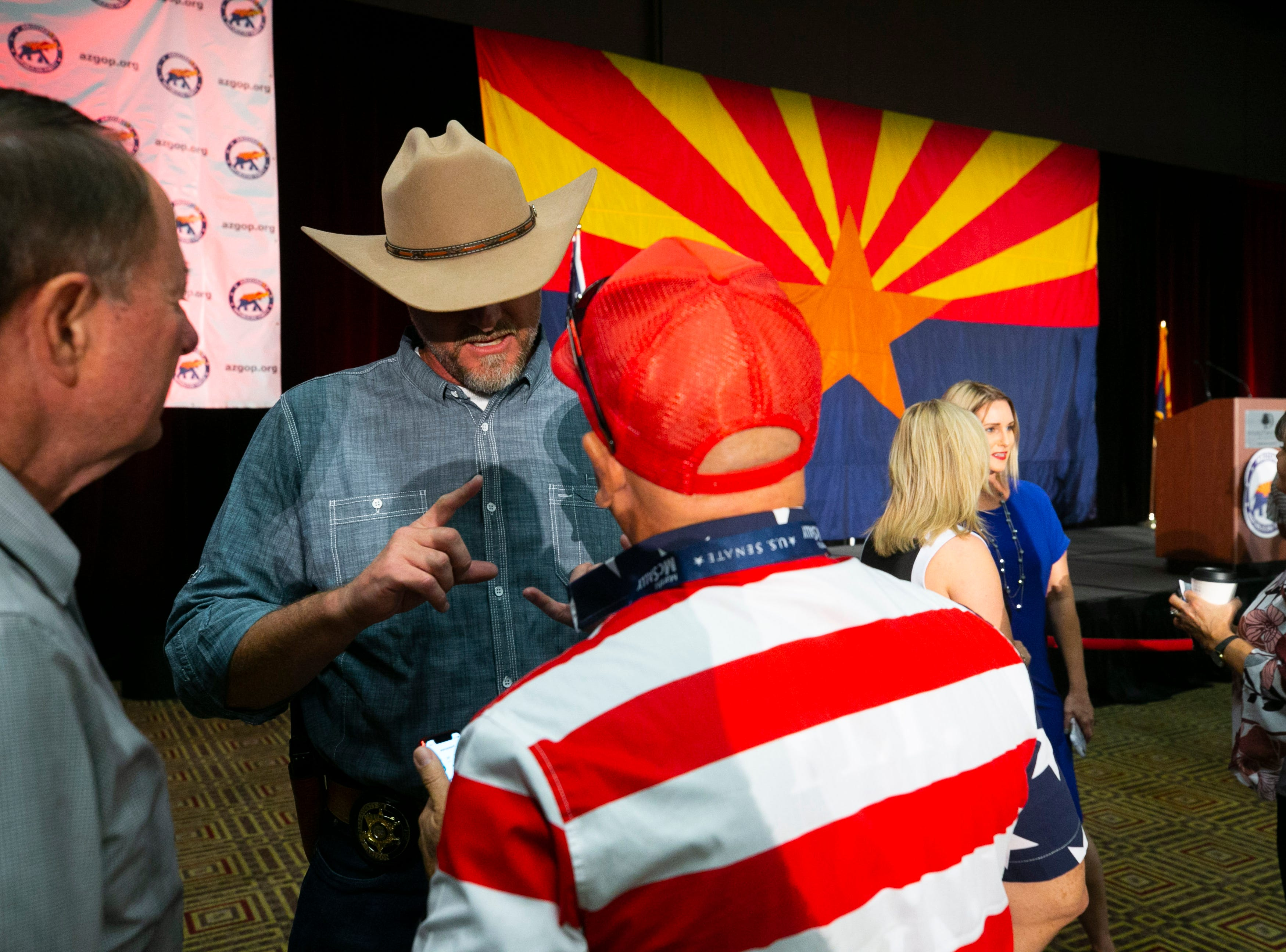 Pinal County Sheriff Mark Lamb (left) talks to fellow Republicans at the Republican watch party at the DoubleTree Resort in Scottsdale on Election Day for the midterms on Tuesday, November 6, 2018.