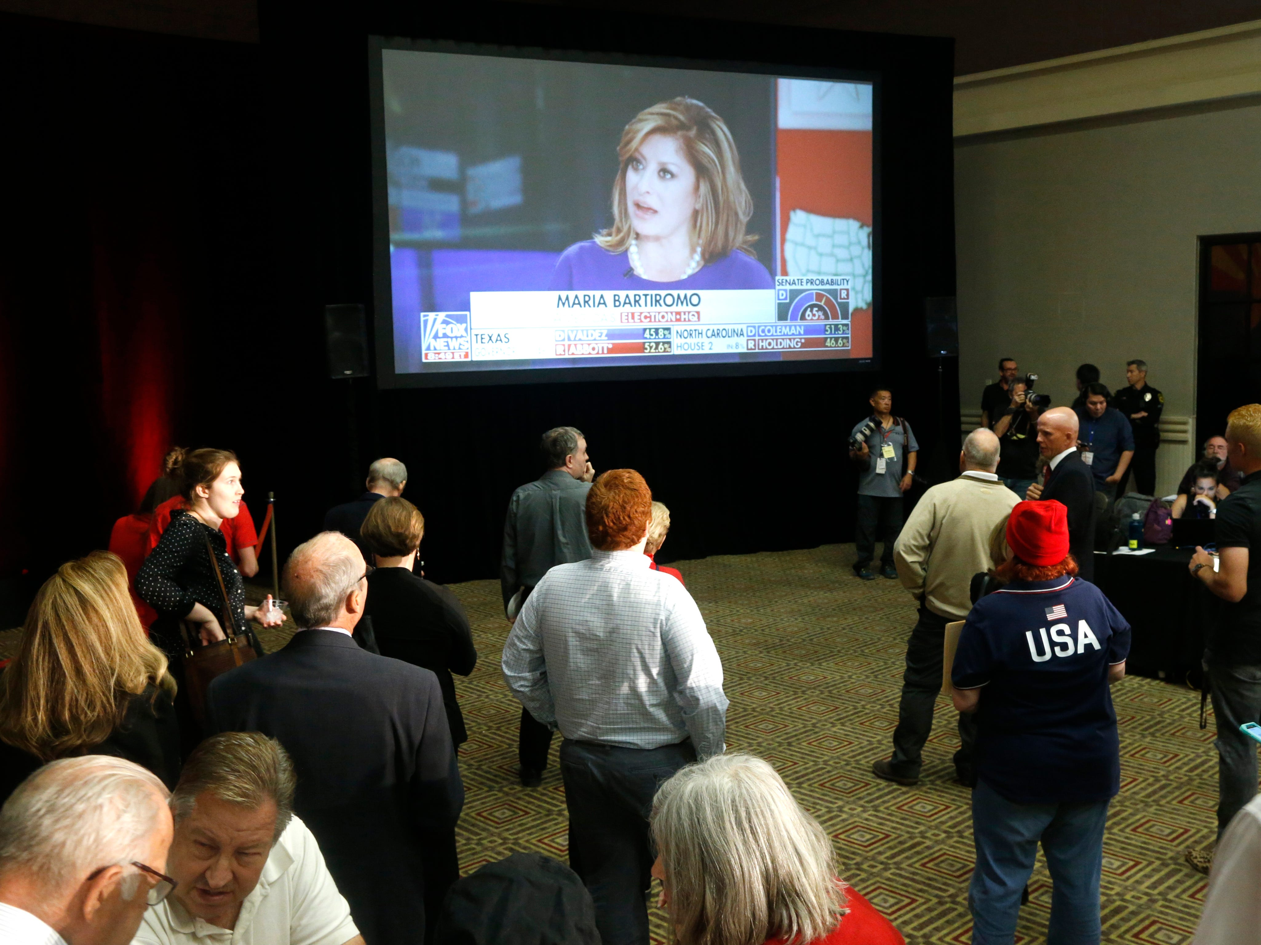 Republicans watch the results roll in on Fox News early in the night at the DoubleTree Resort in Scottsdale on Nov. 6, 2018.
