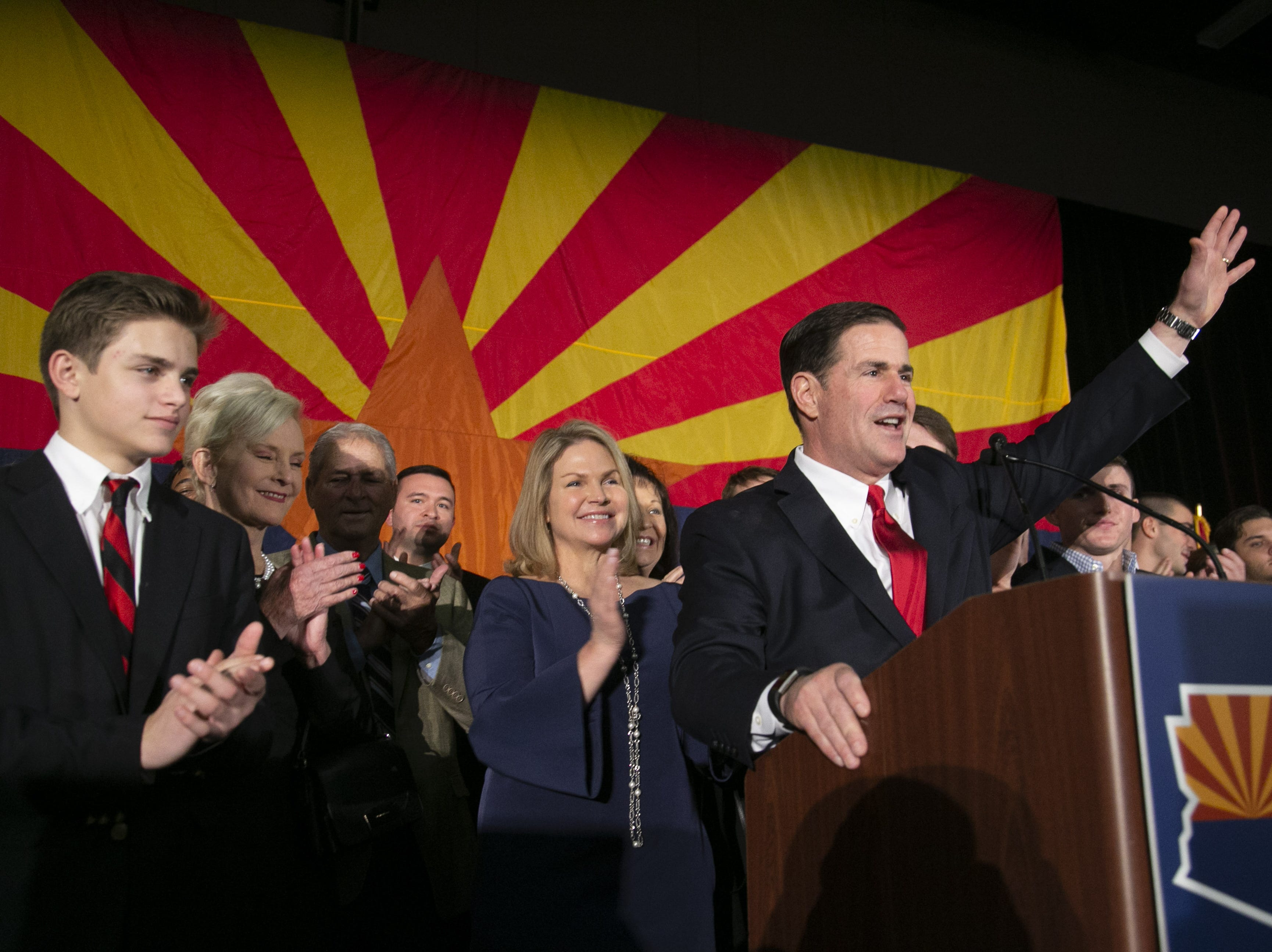 Governor Doug Ducey speaks alongside his wife, Angela, during the Republican watch party at the DoubleTree Resort in Scottsdale on  Nov. 6, 2018.