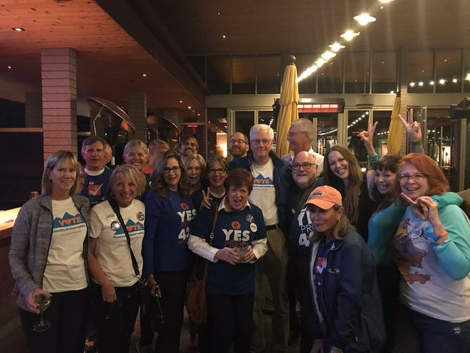 The residents behind the citizen's initiative to put Proposition 420 on the ballot celebrate its passage at The Vig in north Scottsdale on Tuesday.