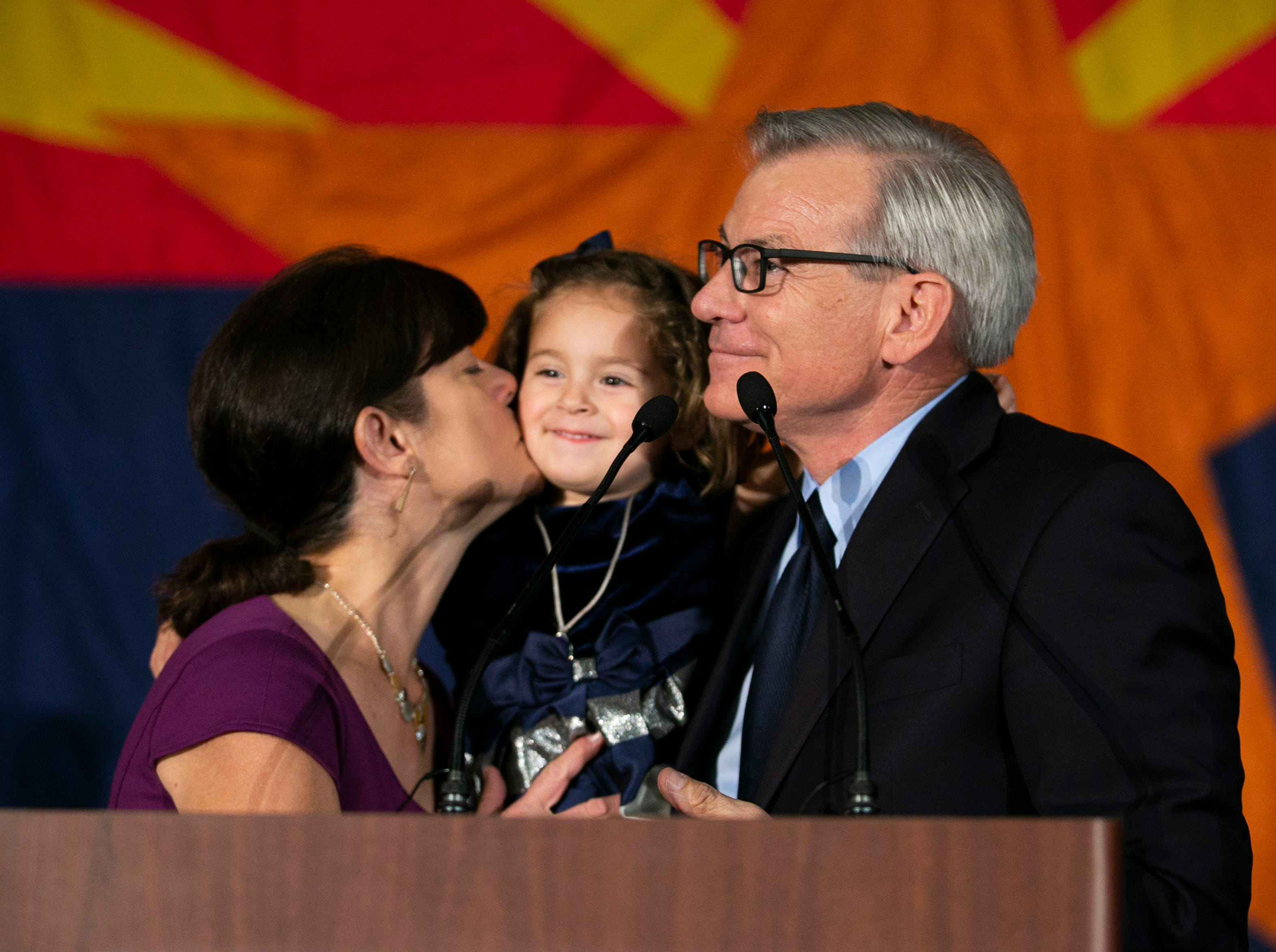 U.S. Representative David Schweikert speaks as his wife, Joyce, kisses their daughter, Olivia, during the Republican watch party at the DoubleTree Resort in Scottsdale on Election Day for the midterms on Nov. 6, 2018.