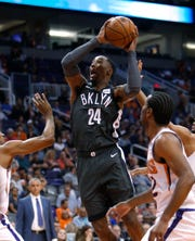 Nets forward Rondae Hollis-Jefferson splits the Suns defense during a game Tuesday at Talking Stick Resort Arena.