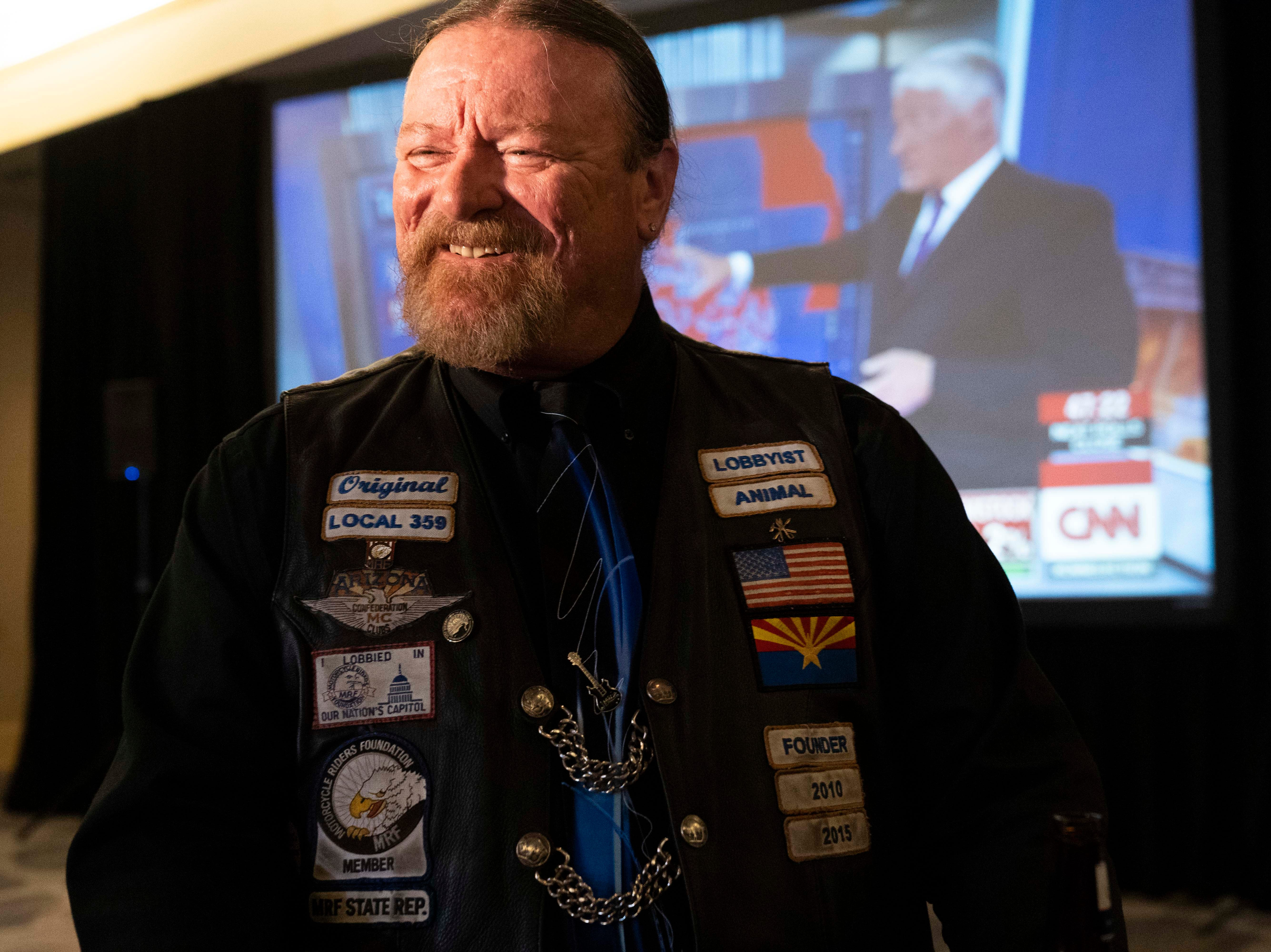 Democrat supporter Dale Dedrick cheers after hearing national results on CNN at the Renaissance Phoenix Downtown Hotel on Nov. 6, 2018.