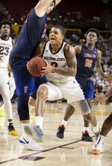 Guard Rob Edwards (2) of the Arizona State Sun Devils drives to the basket against forward Amel Kuljuhovic (22) of the Cal State Fullerton Titans at Wells Fargo Arena on Tuesday, November 6, 2018 in Tempe, Arizona.