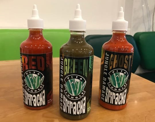 Pita Jungle's Sriracha sauces include Red, Green and Ghost. Each bottle of Sriracha retails for $5.99.