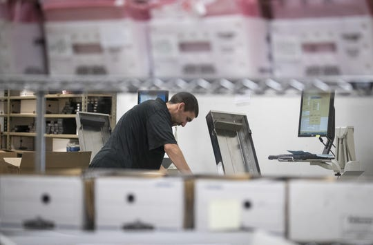 Ballots are processed on Nov. 7, 2018, at the Maricopa County Tabulation and Election Center, on 510 S. Third Ave., Phoenix.
