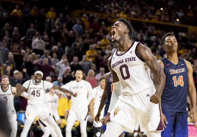 Guard Luguentz Dort (0) of the Arizona State Sun Devils reacts following a three-point play against the Cal State Fullerton Titans at Wells Fargo Arena on Tuesday, November 6, 2018 in Tempe, Arizona.