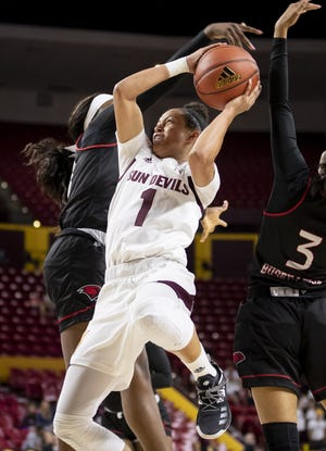 Guard Reili Richardson (1) of the Arizona State Sun Devils shoots against guard Alexandra Busby-Leija (3) of the Incarnate Word Cardinals at Wells Fargo Arena on Tuesday, November 6, 2018 in Tempe, Arizona.