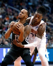 Brooklyn Nets guard Shabazz Napier (13) gets pressured by Phoenix Suns forward Richaun Holmes during the first half of an NBA basketball game Tuesday, Nov. 6, 2018, in Phoenix. (AP Photo/Rick Scuteri)
