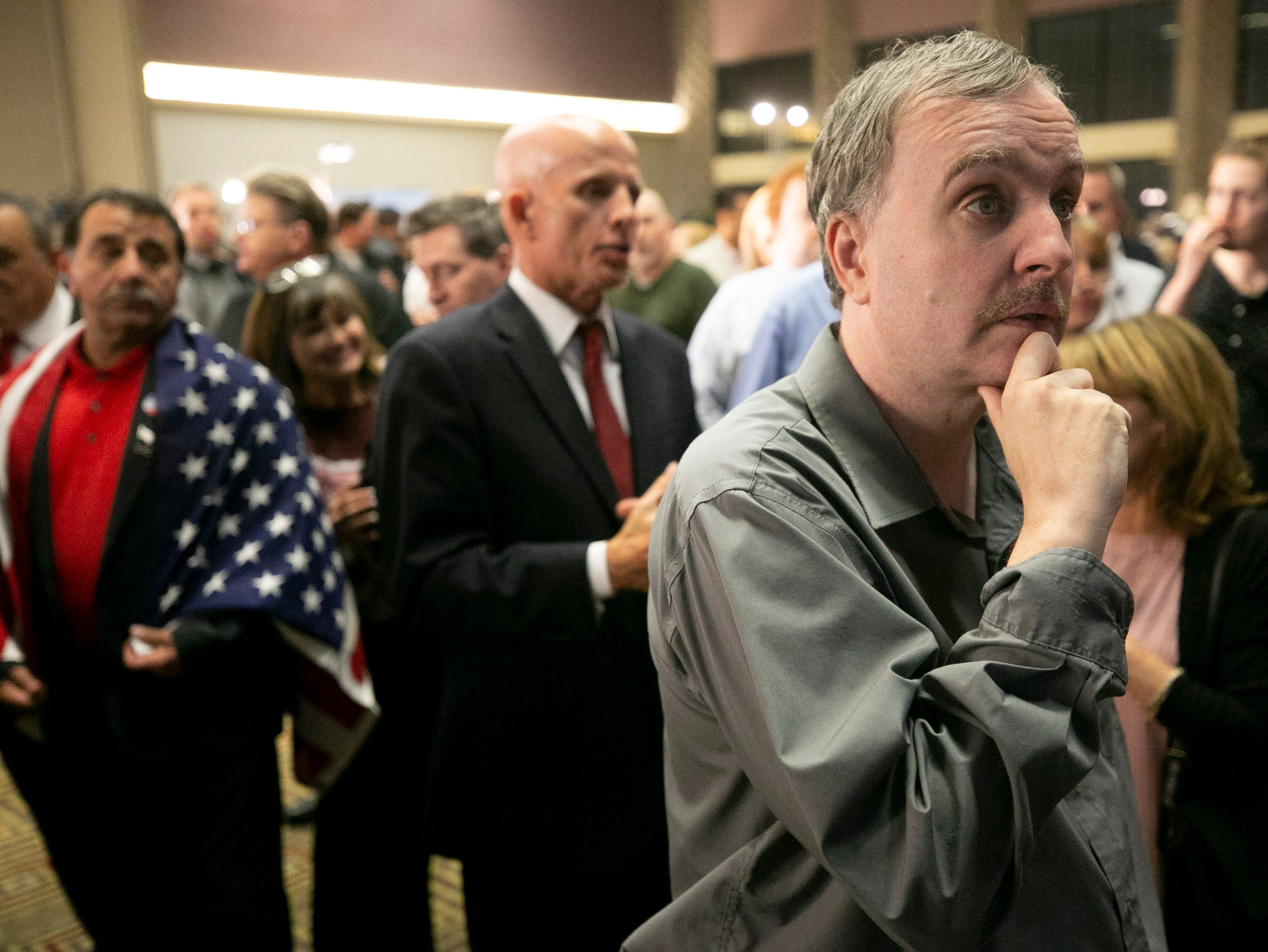 Republican Stephen Fischer of Surprise watches early results during the Republican watch party at the DoubleTree Resort in Scottsdale on Election Day for the midterms on Tuesday, November 6, 2018.