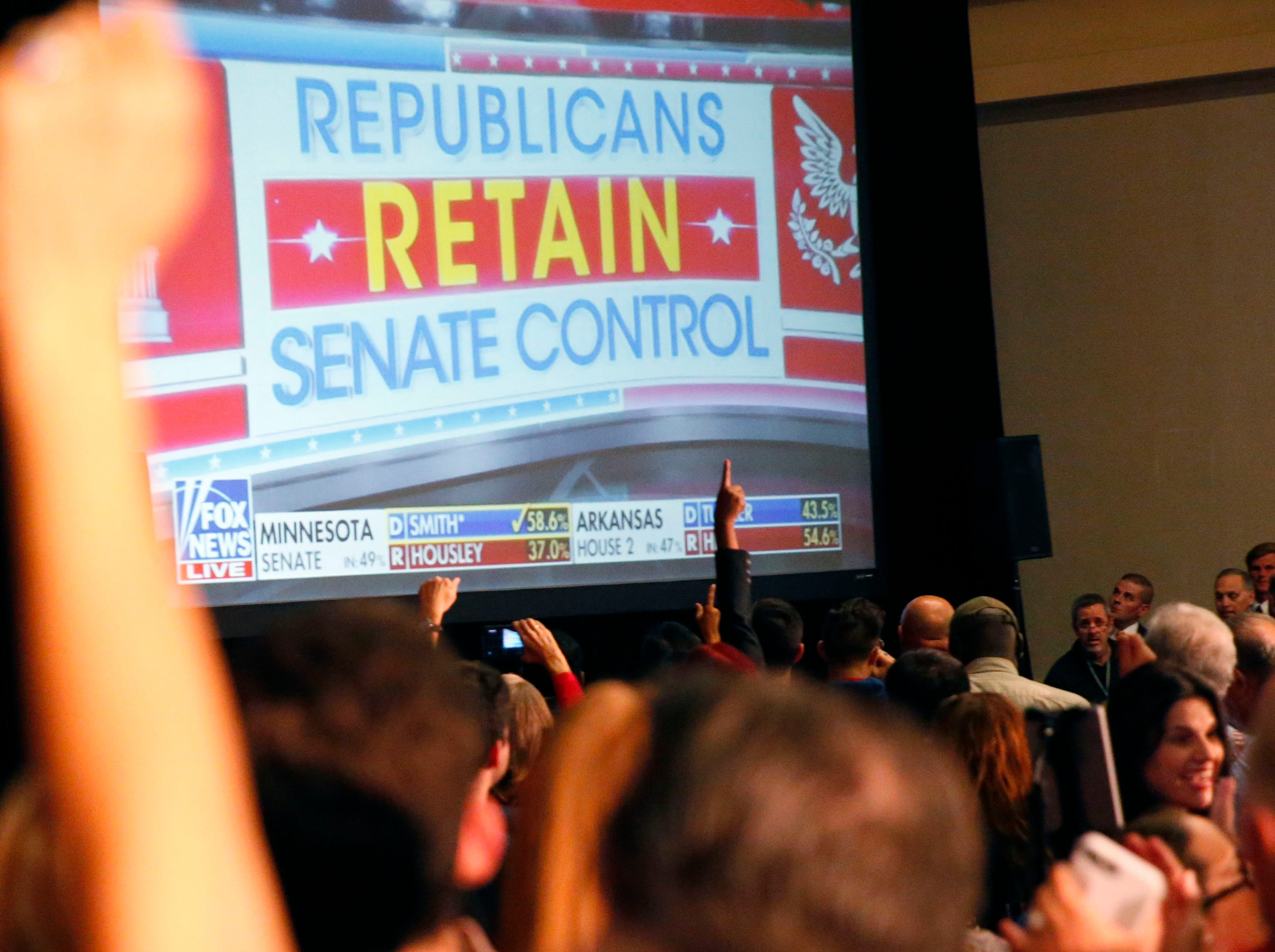 Supporters celebrate after a Fox News projects Republicans retain control of the Senate during the Arizona Republican Party Election Night party in Scottsdale Nov. 6, 2018.