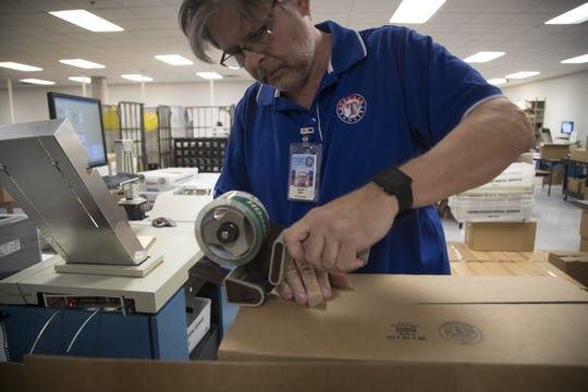 Steven Borth processes ballots on Nov. 7, 2018, at the Maricopa County Tabulation and Election Center, 510 S. 3rd Ave., Phoenix.