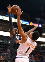 Brooklyn Nets guard Caris LeVert (22) pressures Phoenix Suns guard Devin Booker during the second half of an NBA basketball game Tuesday, Nov. 6, 2018, in Phoenix. The Nets won 104-82. (AP Photo/Rick Scuteri)