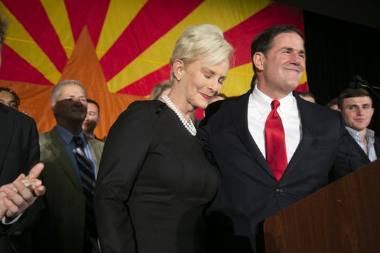 Gov. Doug Ducey speaks as Cindy McCain, the wife of the late Senator John McCain looks on during the Republican watch party at the DoubleTree Resort in Scottsdale on Nov. 6, 2018.