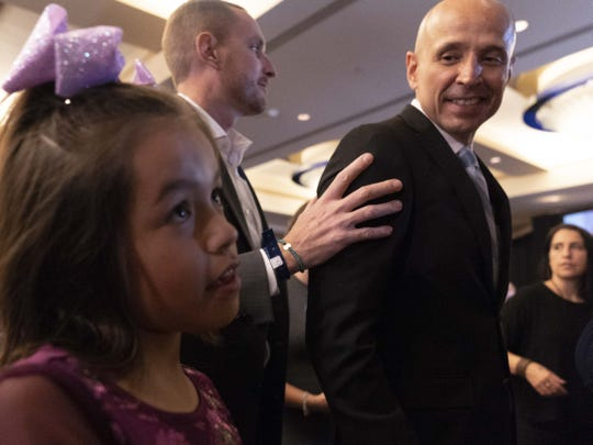 David Garcia, Democratic candidate for Arizona governor with his daughter Lola walks out after giving his concession speech at the Renaissance Phoenix Downtown Hotel on Nov. 6, 2018.