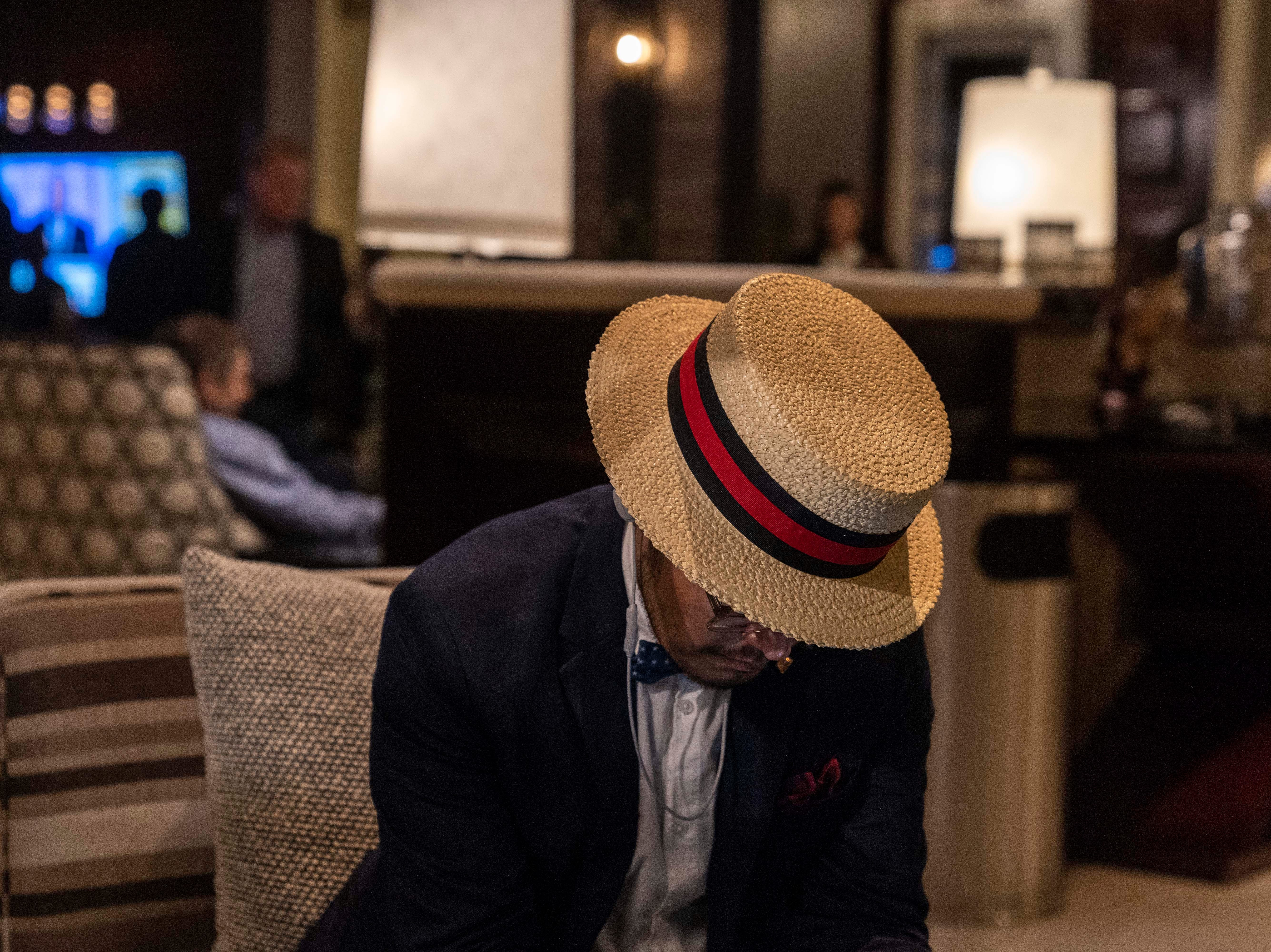 Democrat supporter Douglas Capitan checks his tweets at the Renaissance Phoenix Downtown Hotel on Nov. 6, 2018.