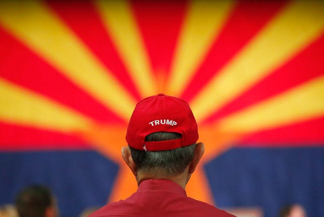 Larry Hagan watches election returns at the Arizona Republican Party Election Night party in Scottsdale Nov. 6, 2018.