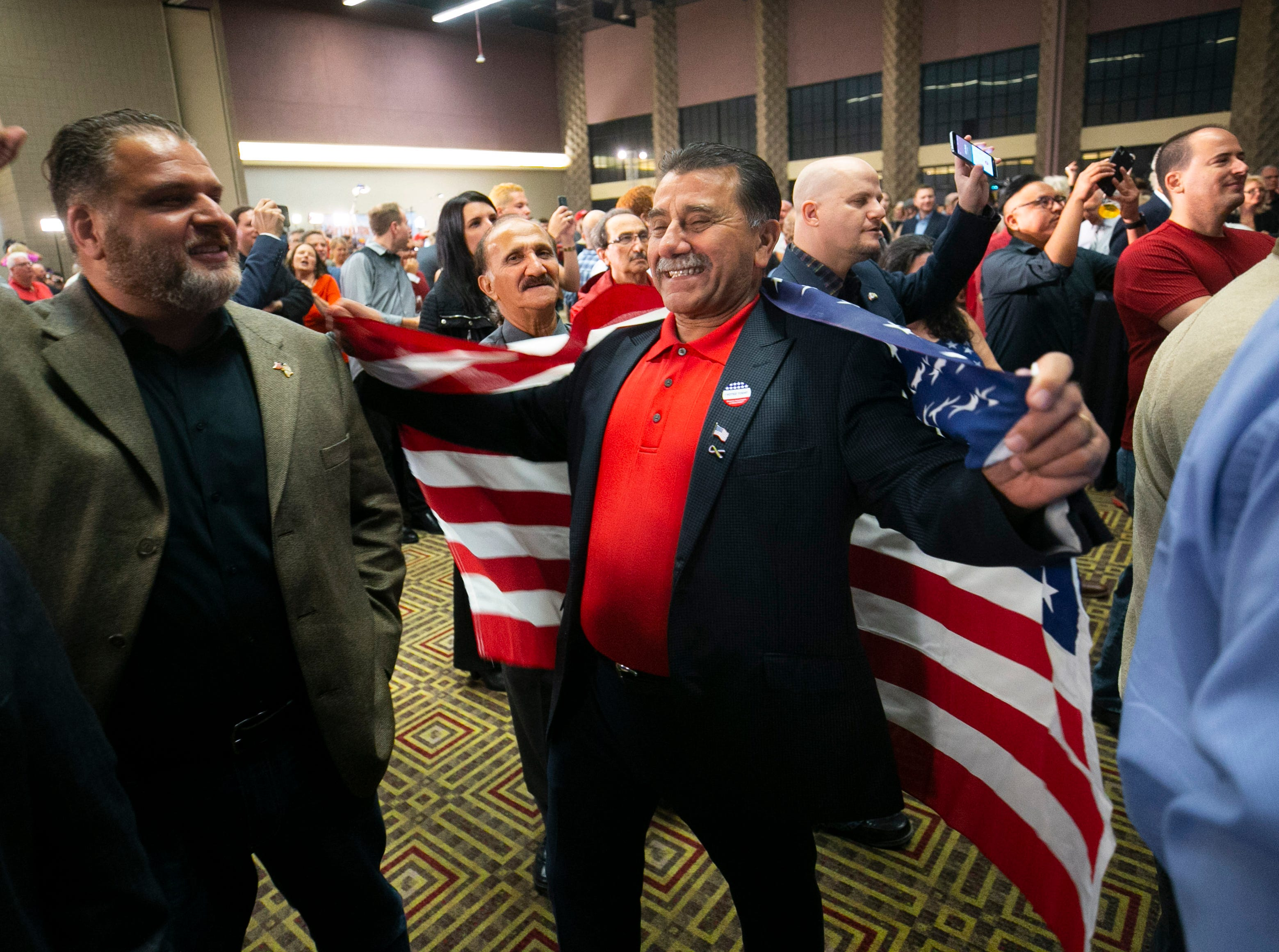 Republicans Michael Jabri of Phoenix (left) of Phoenix and Ashur Warda of Peoria watch early results during the Republican watch party at the DoubleTree Resort in Scottsdale on Election Day for the midterms on Tuesday, November 6, 2018.