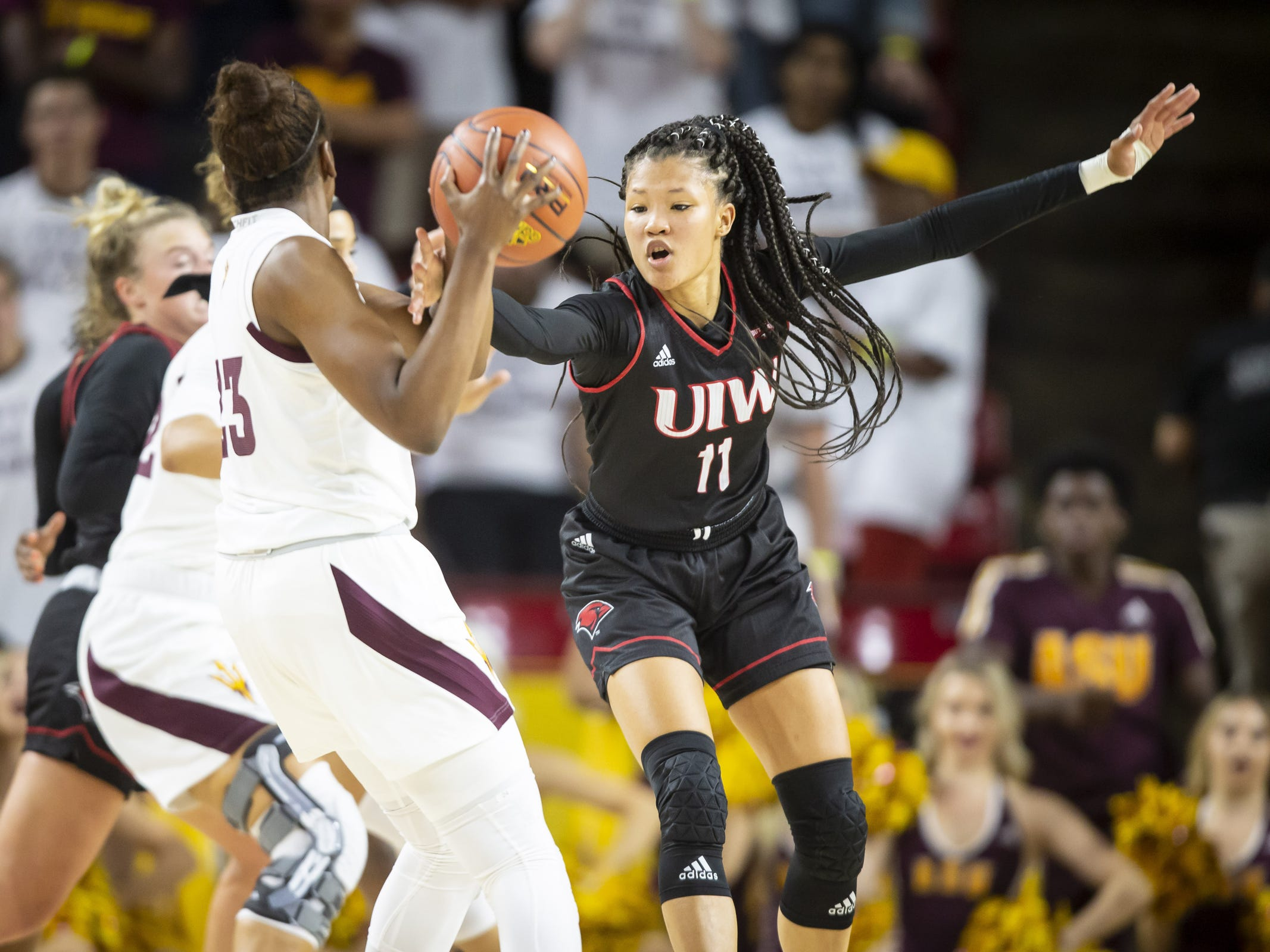 Guard Imani Robinson (11) of the Incarnate Word Cardinals reaches for the ball against forward Iris Mbulito (23) of the Arizona State Sun Devils at Wells Fargo Arena on Tuesday, November 6, 2018 in Tempe, Arizona.