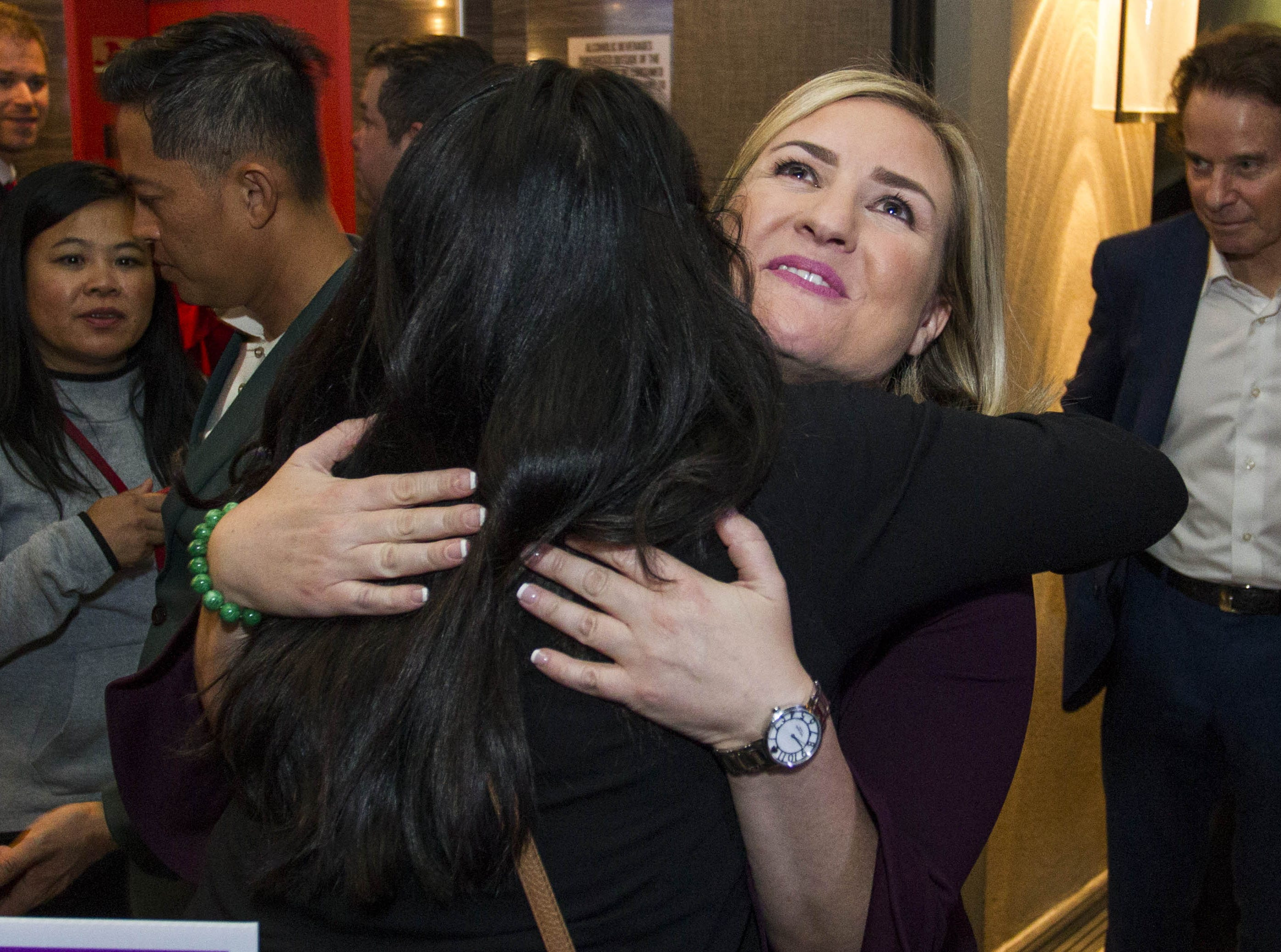 Phoenix mayoral candidate Kate Gallego gets a hug from a friend at the Hilton Garden Inn in Phoenix on Nov. 6, 2018.