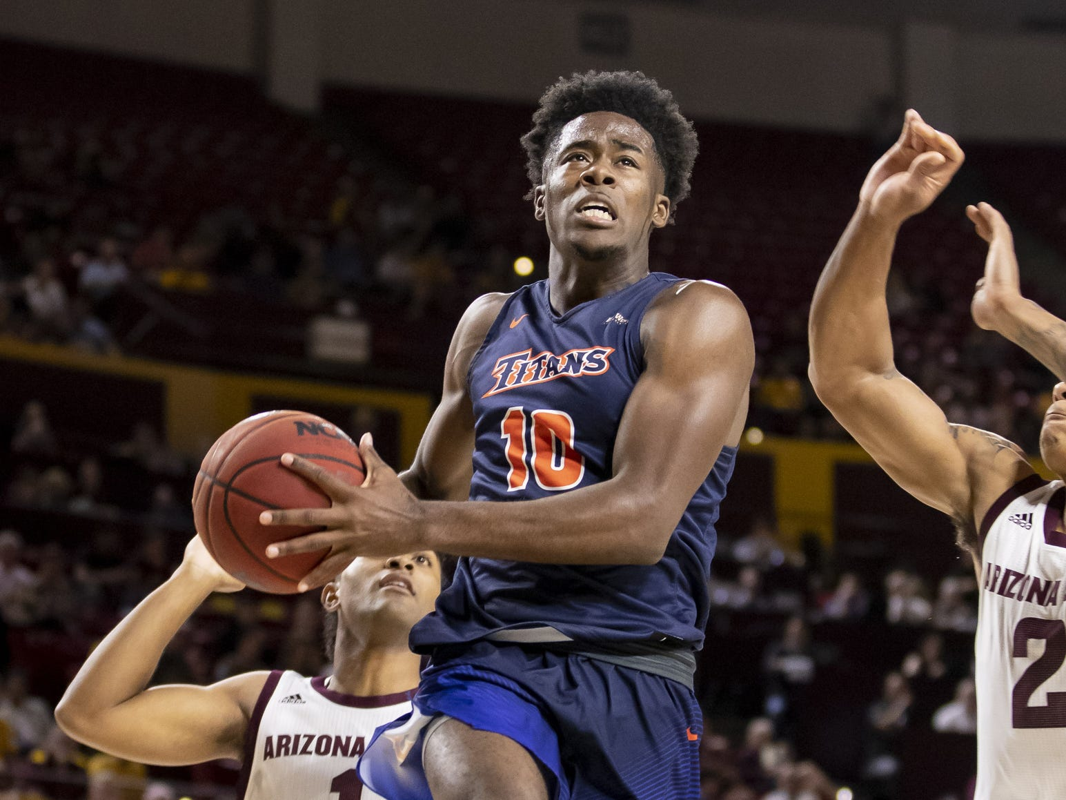 Guard Austen Awosika (10) of the Cal State Fullerton Titans drives to the basket against the Arizona State Sun Devils at Wells Fargo Arena on Tuesday, November 6, 2018 in Tempe, Arizona.