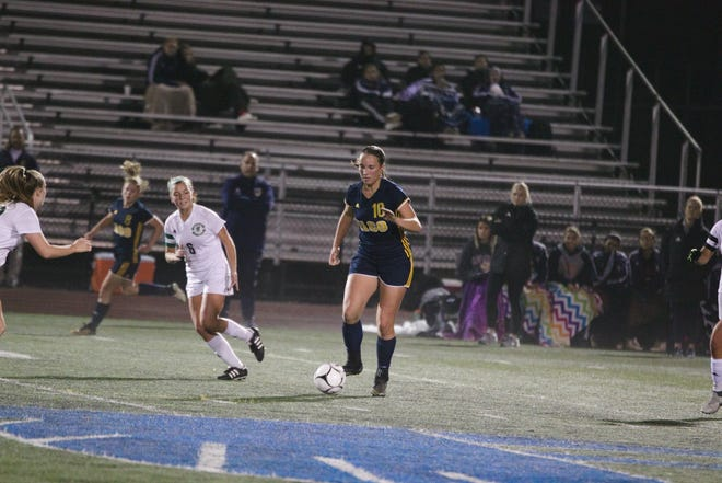 Elco's Ryelle Shuey finds an opening in the Lewisburg defense.